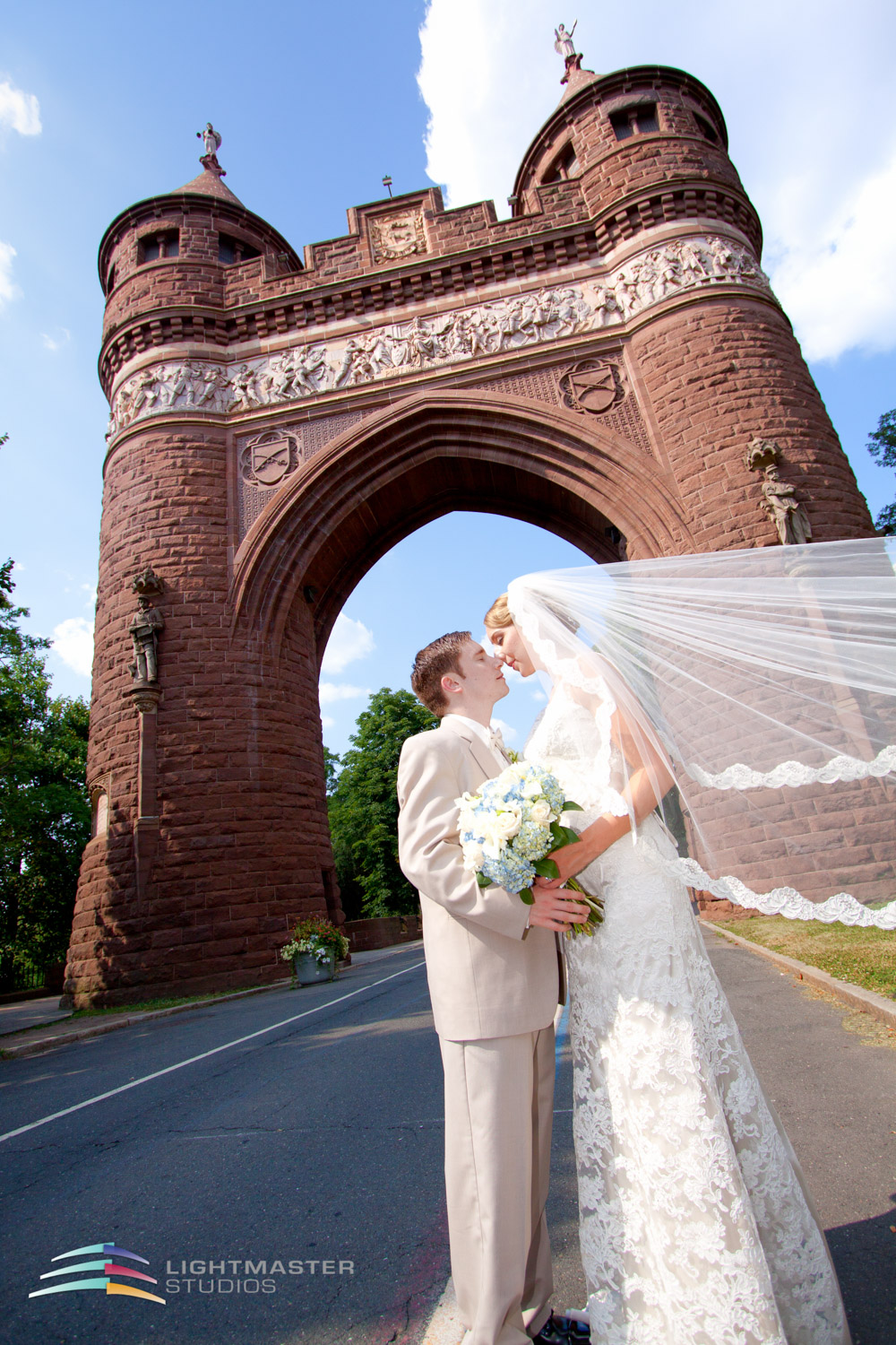 Wedding-couple-Soldiers-and-sailors-memorial-arch-A-line-wedding-dress-and beaded-veil