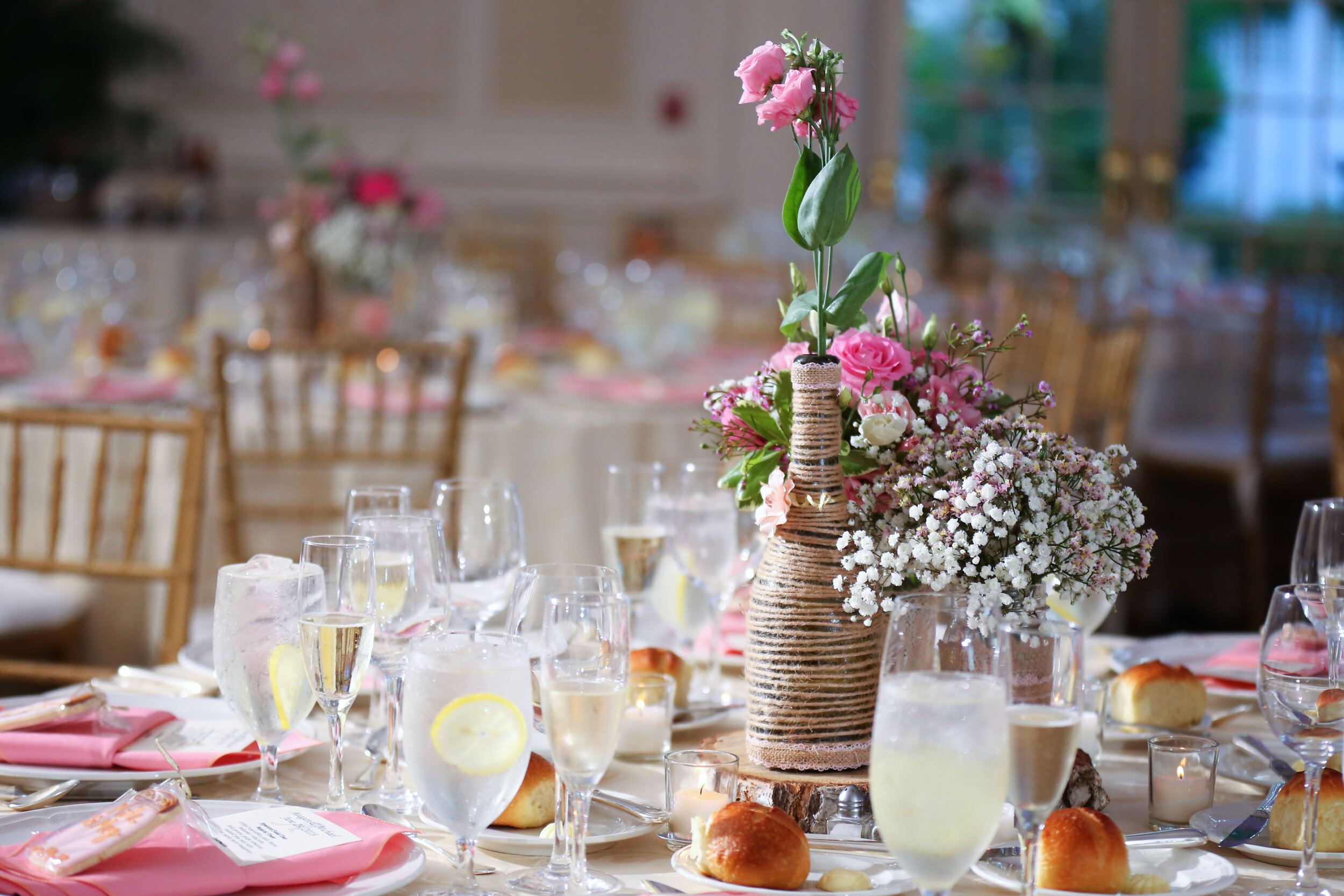 LightMaster-Studios-wedding-reception-at-the-meadow-wood-manor-in with-floral-arrangements-pink-and white-flowers-with-back-lighting-Lo-Rez-.jpg