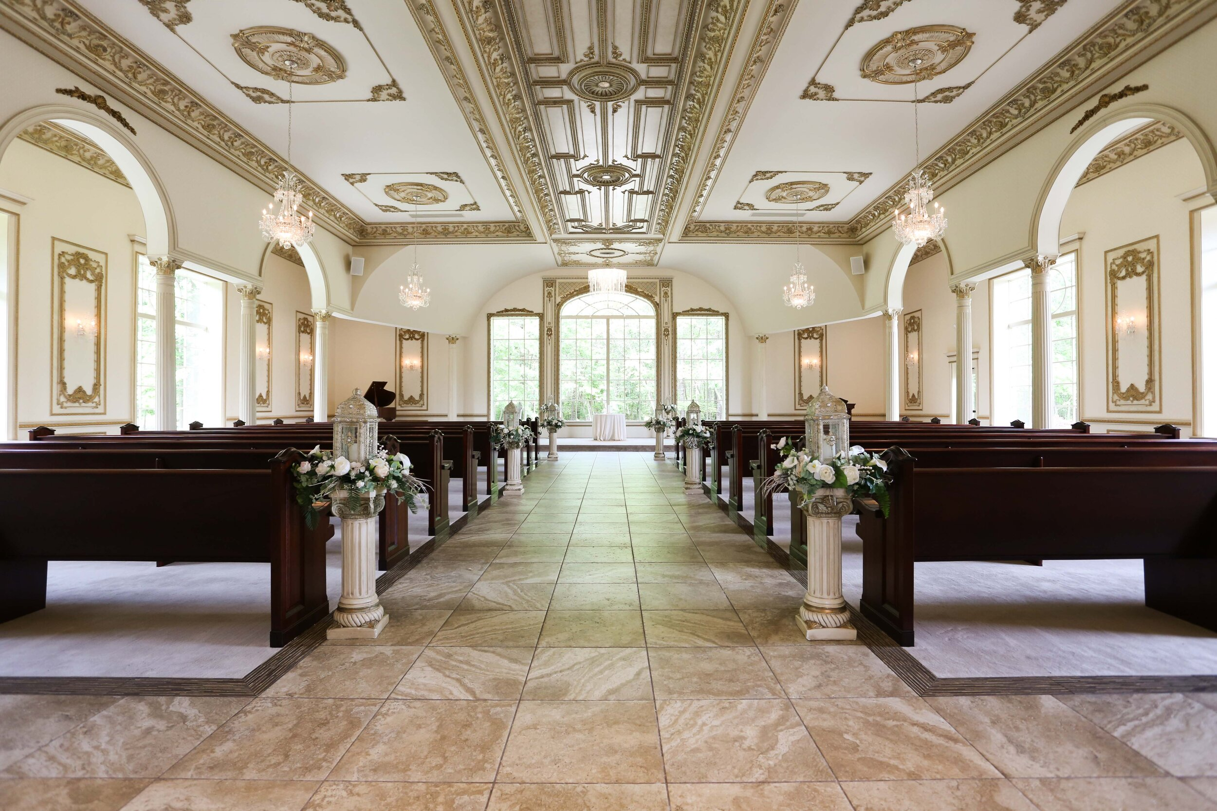 LightMaster-Studios-wedding-chapel-at-the-brigalia-with-floral-arrangements-white-flowers-on-chapel-pews-Lo-Rez-0153.jpg