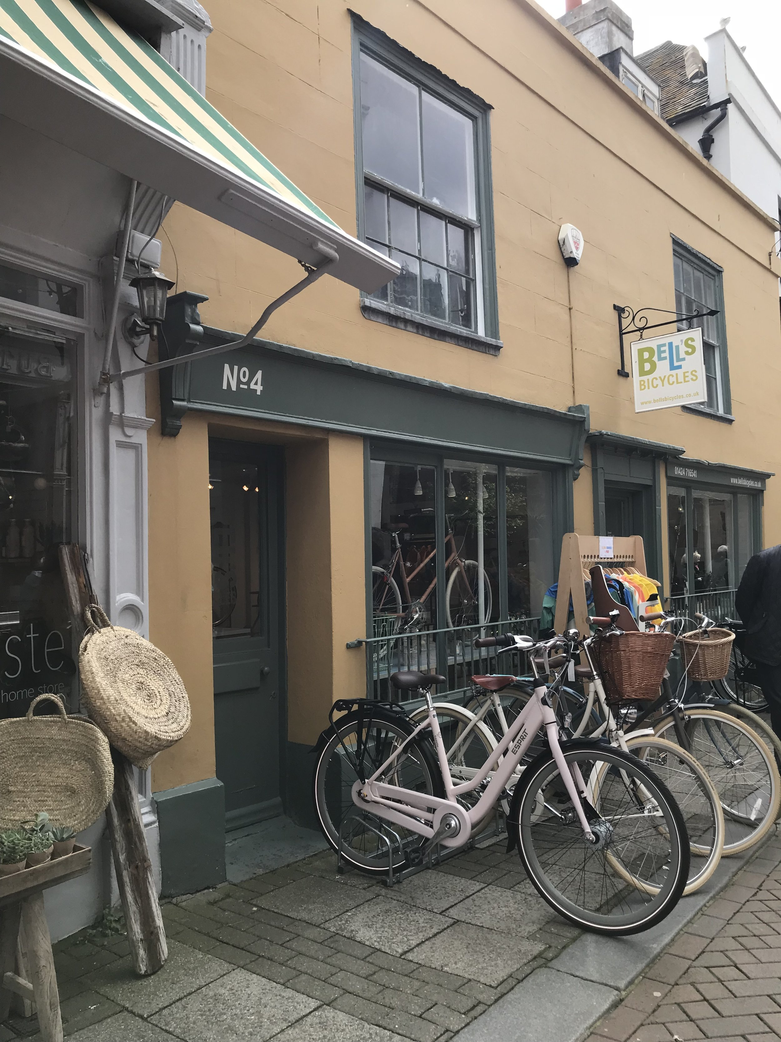 A quaint little cycle shop - but hang on! Look at those baskets