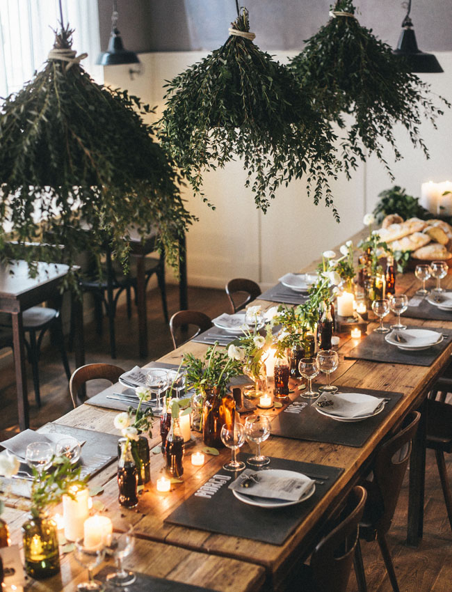 All you need is candles and foliage to create a cosy setting - www.ashleymanfred.com