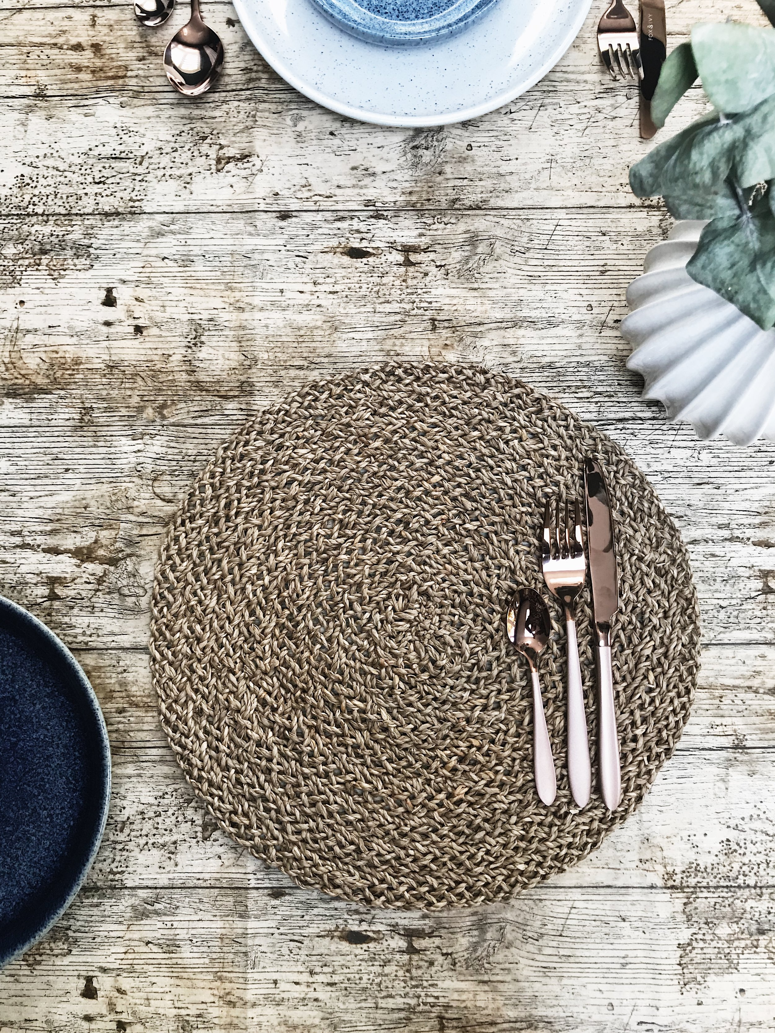 A simple woven seagrass placemat -  Ikea