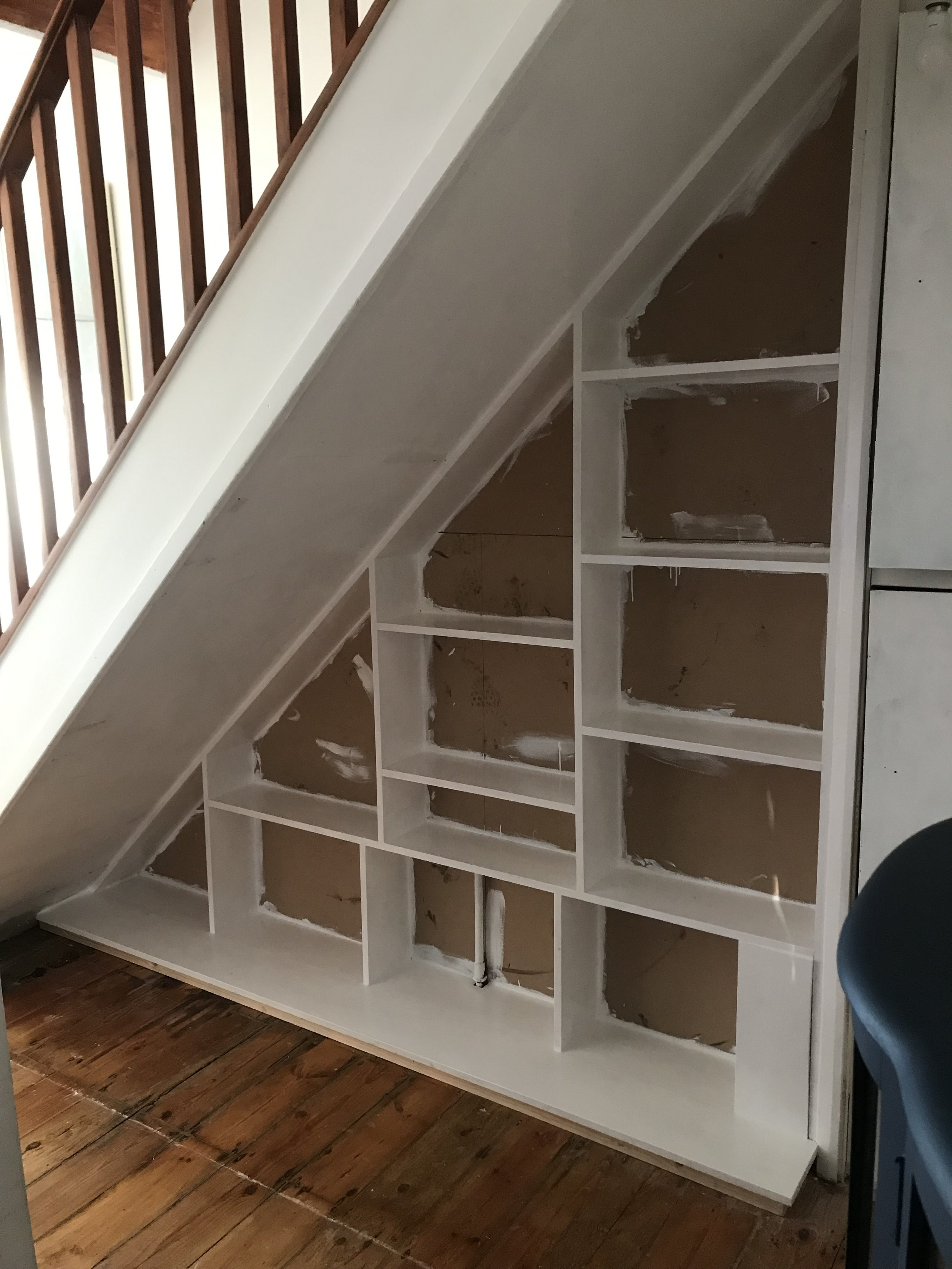 The finished shelves painted white