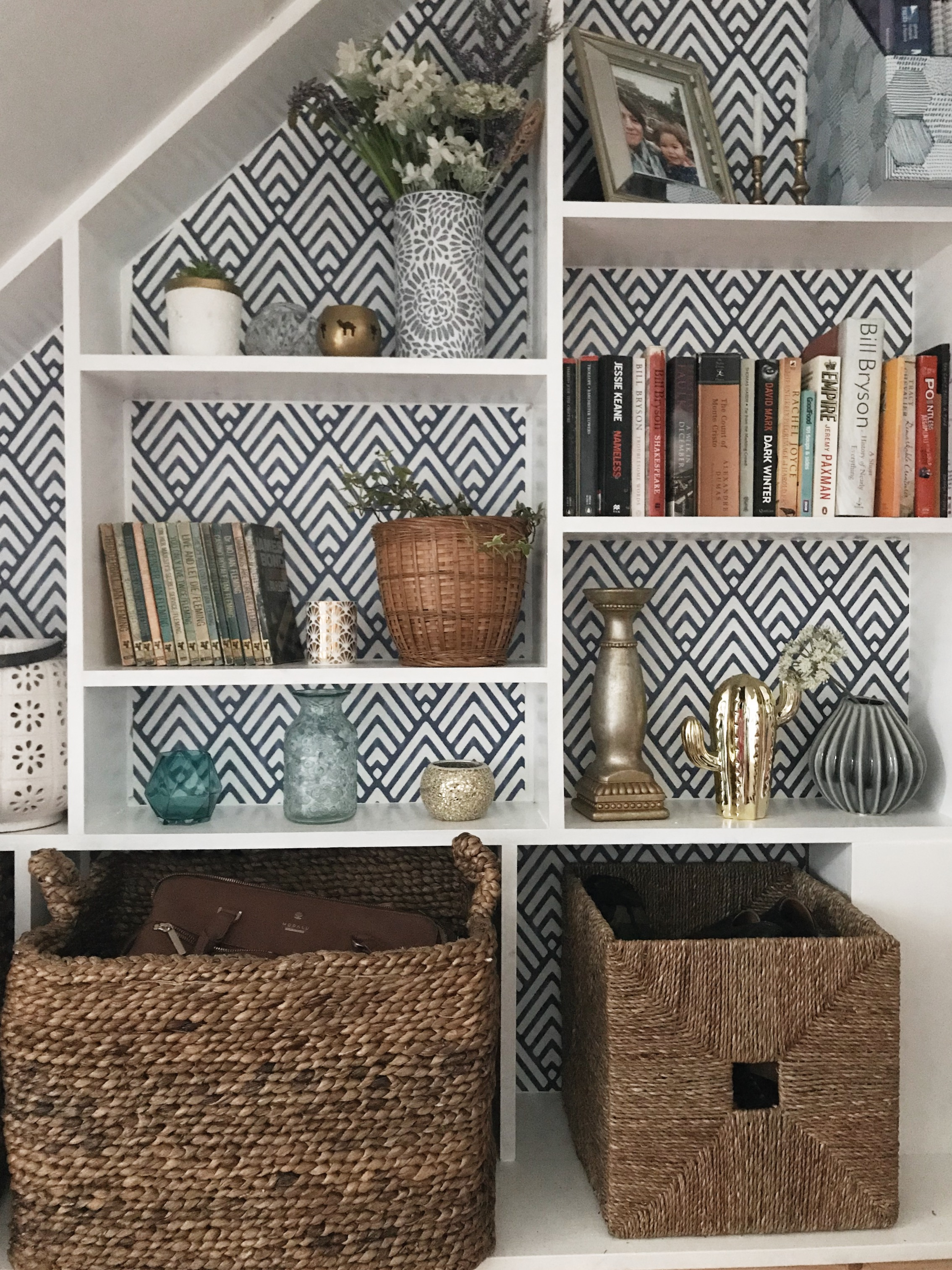 The  baskets  go so well with the wallpaper