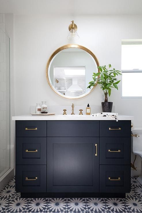 I love the navy blue colour in this bathroom with the gold accessories -  Kirsten Marie Inc.