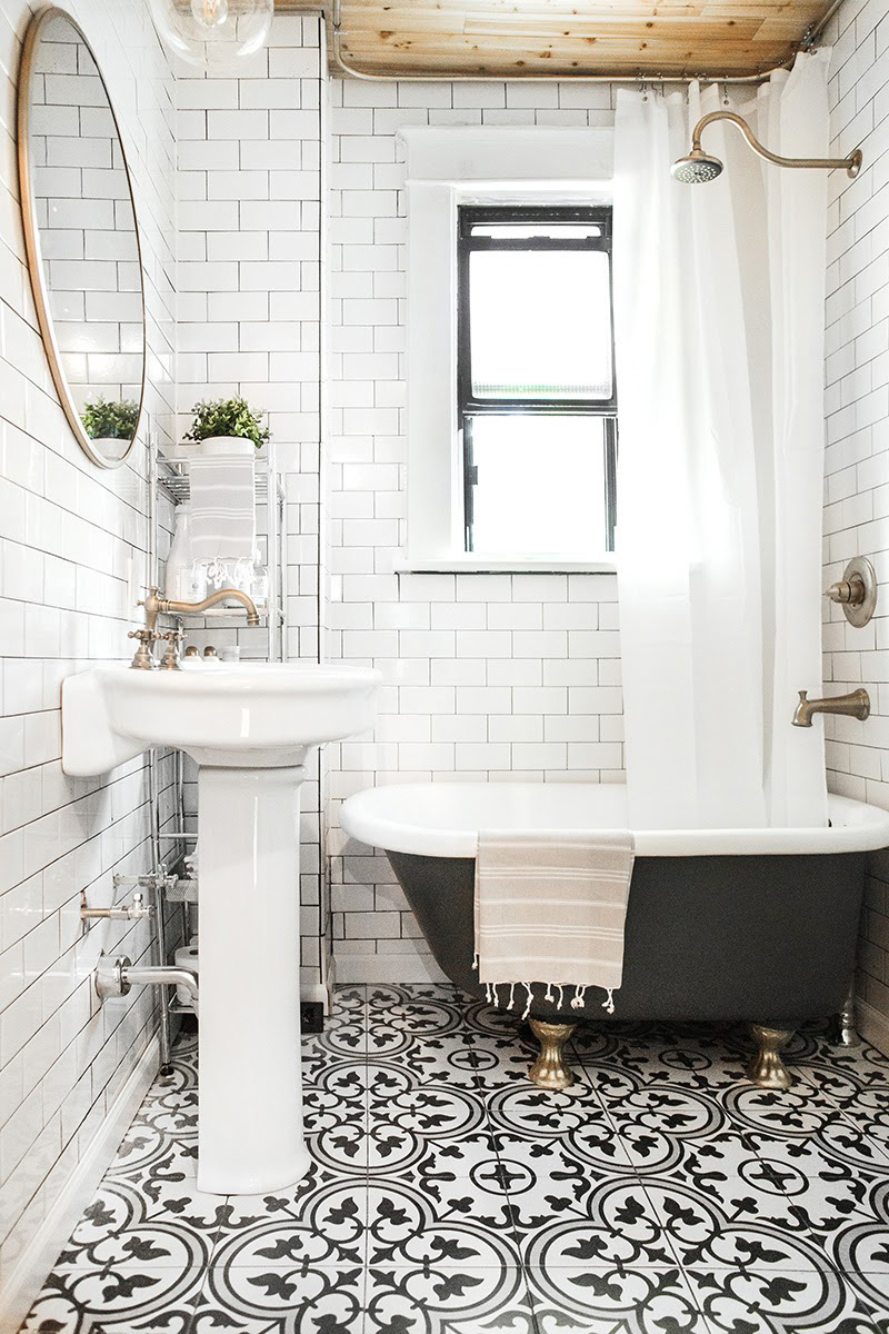 A black bath with brass feet -  Design Sponge
