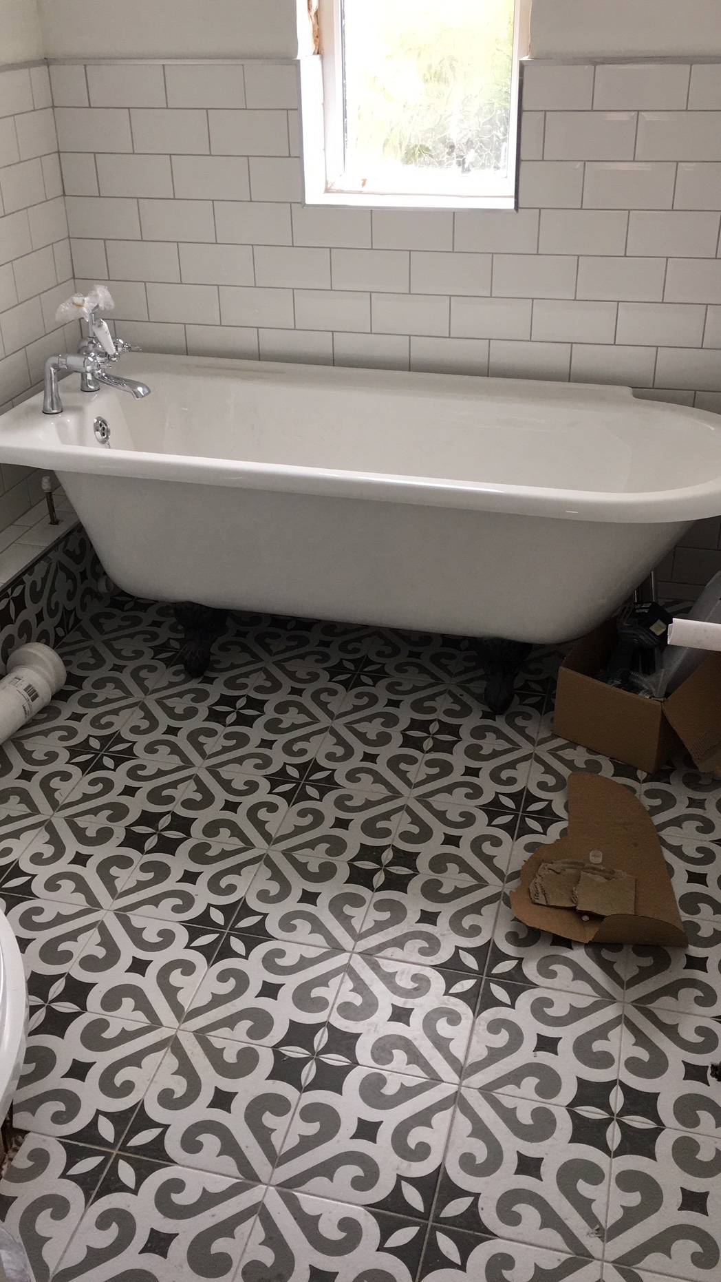 Metro tiles up and new Winchester bath going in