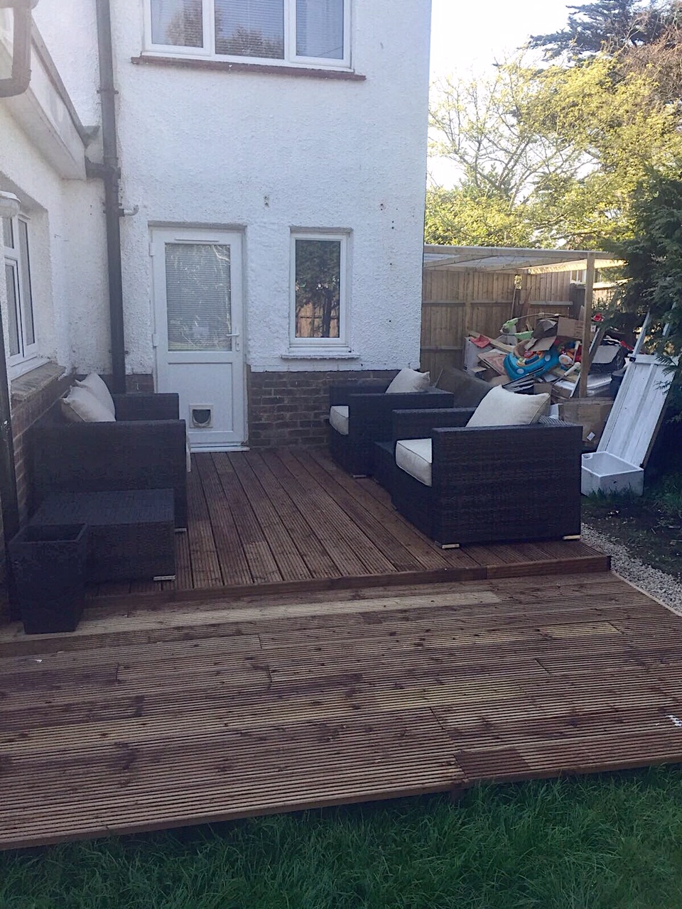 Our newly laid decking, ignore the MASSIVE pile of crap in the background. We were having our kitchen renovated at the same time.