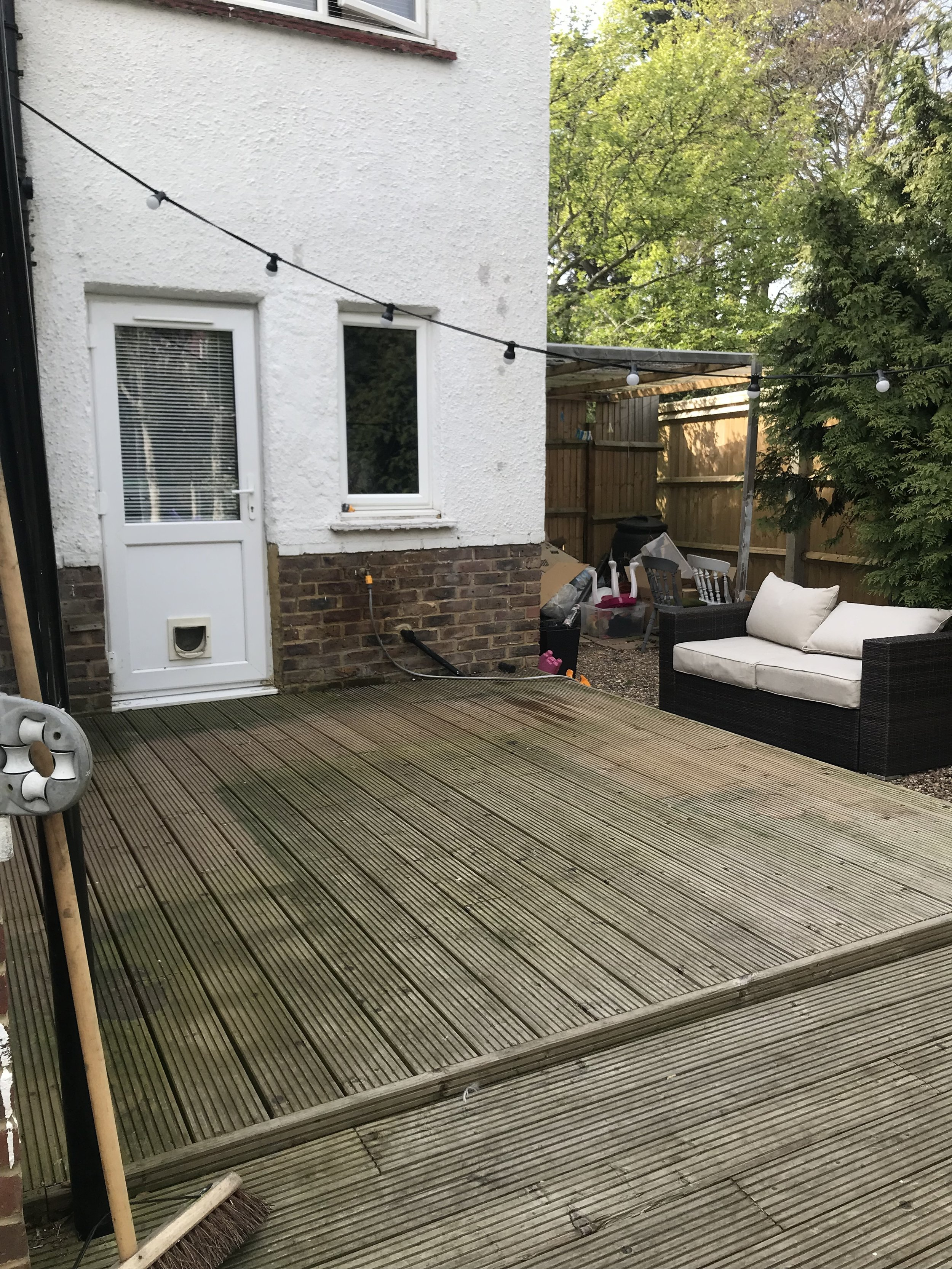 You can make out where the garden furniture was, protecting the decking from the elements!