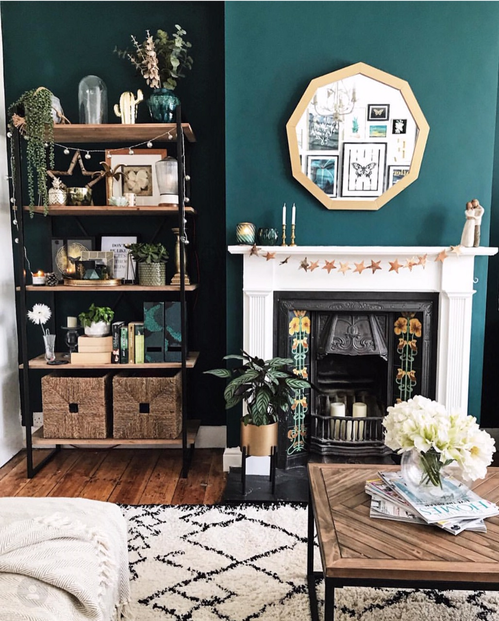 Nine sided mirror, parquet coffee table from  La Redoute , seagrass baskets from  Ikea  and shelving from  Maisons Du Monde