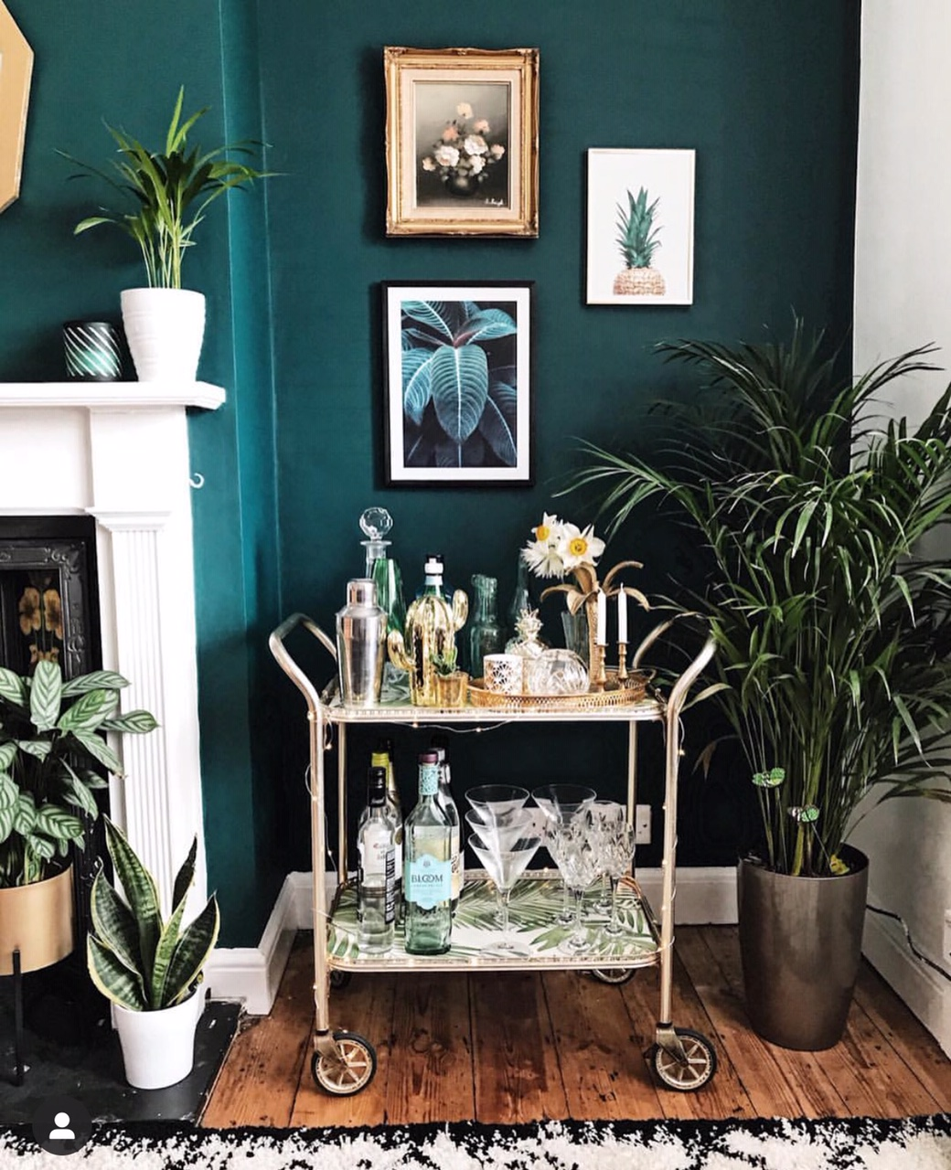 My £15 gold bar cart from a charity shop! The shop assistant was quite surprised when I was adamant I wanted it, but I reckon they're the next big thing! :) Prints from  Desenio