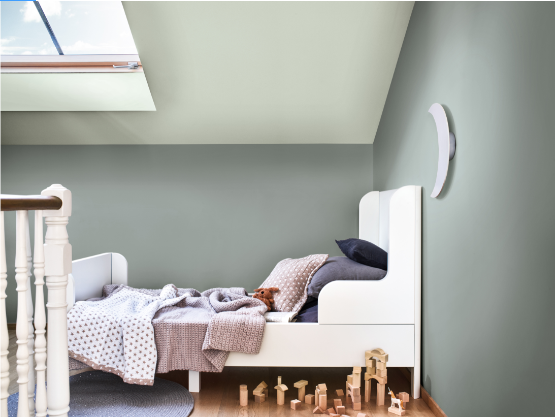 A kids bedroom with serene and calming neutral colours