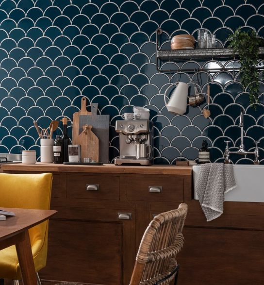 Using dark wood vintage style units, with the  Syren  tile, industrial style shelving and rattan furniture gives this kitchen a very modern rustic look. Credit:  Topps Tiles