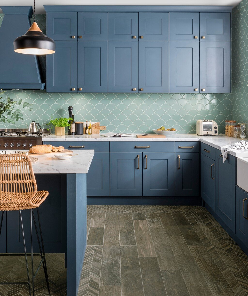 Fresh Sage  in the kitchen with stunning blue kitchen cabinets. Credit:  Topps Tiles