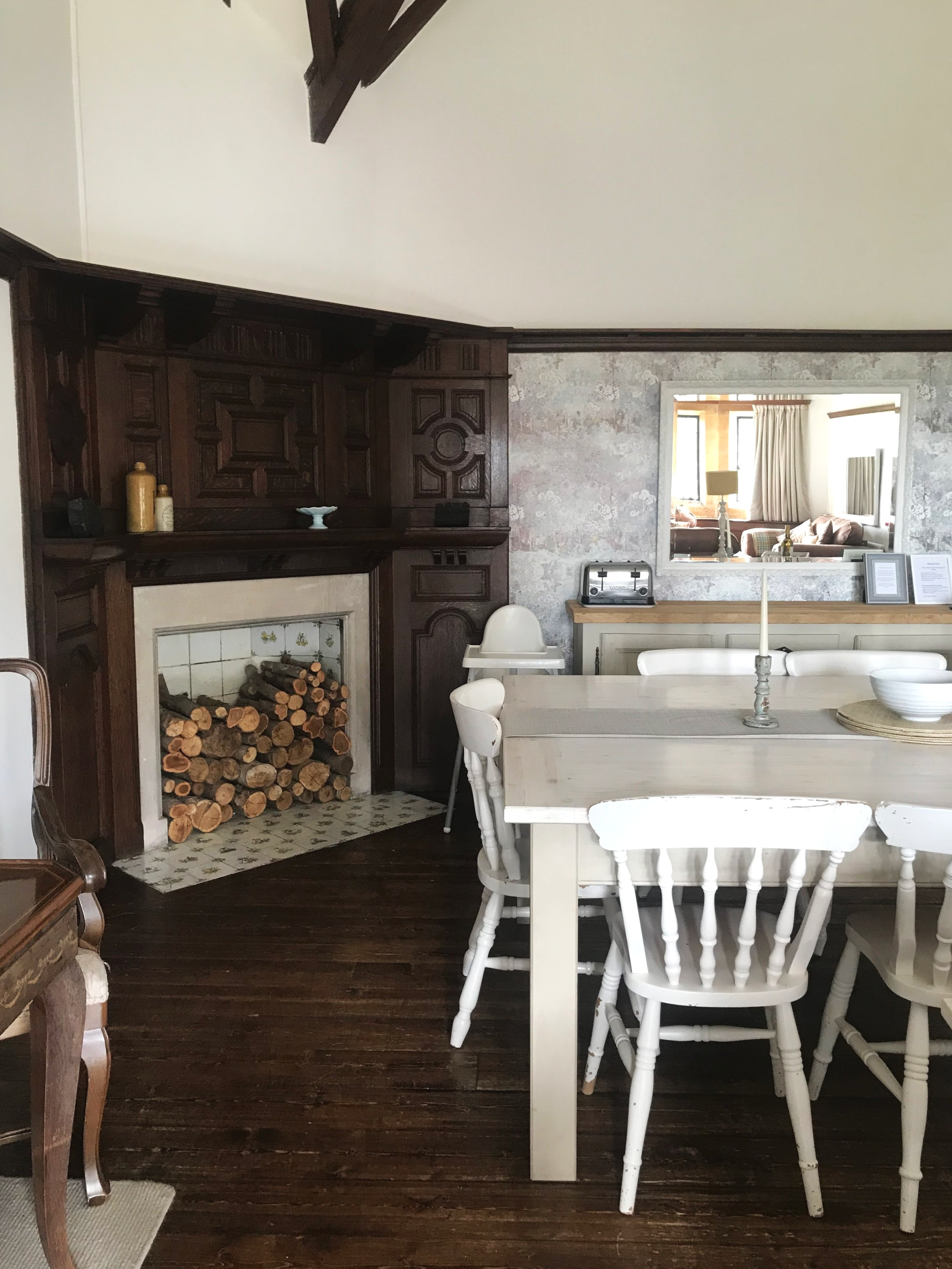 The antique fireplace and dining area of  Affinity