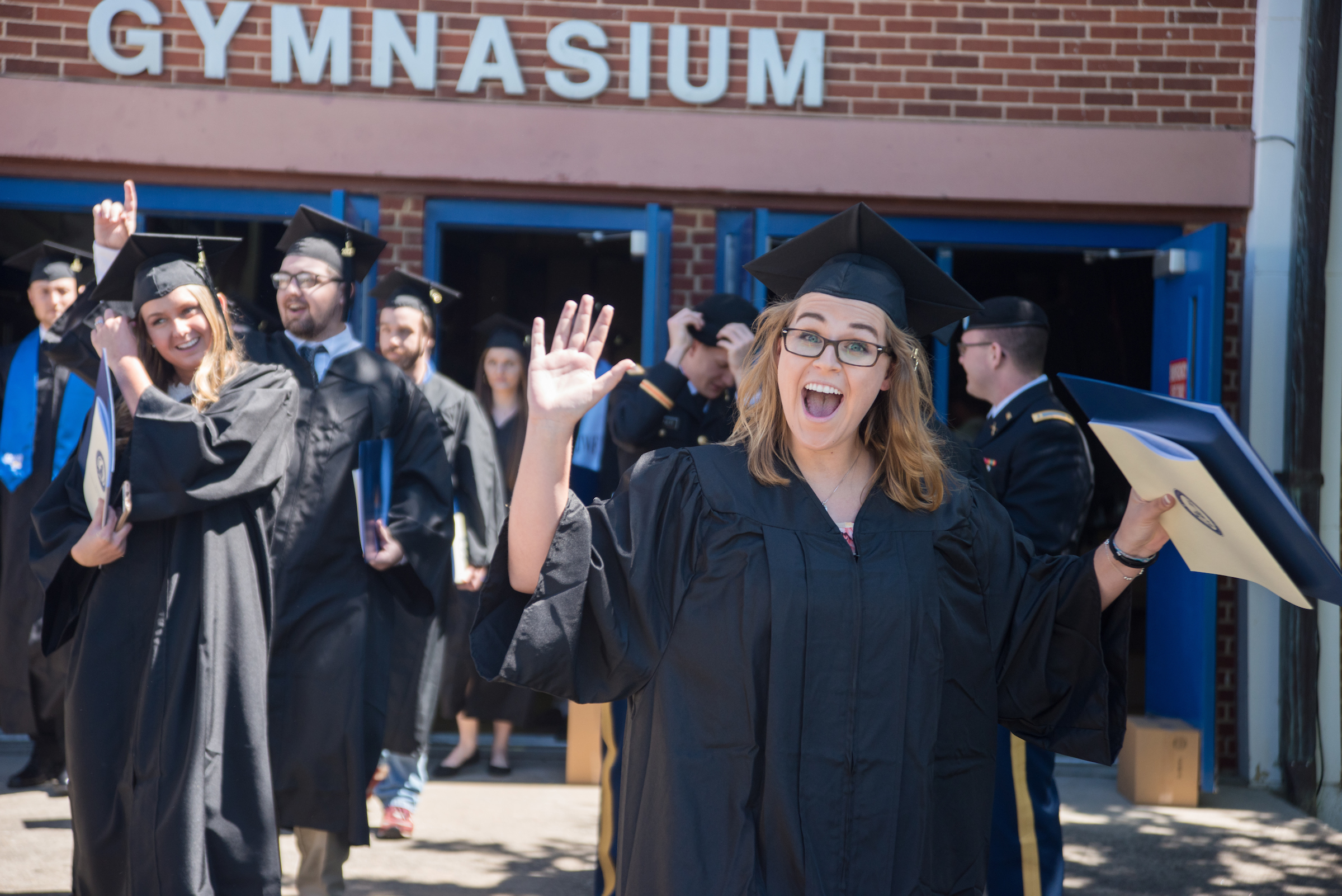 University of North Georgia graduate celebrates after graduating.