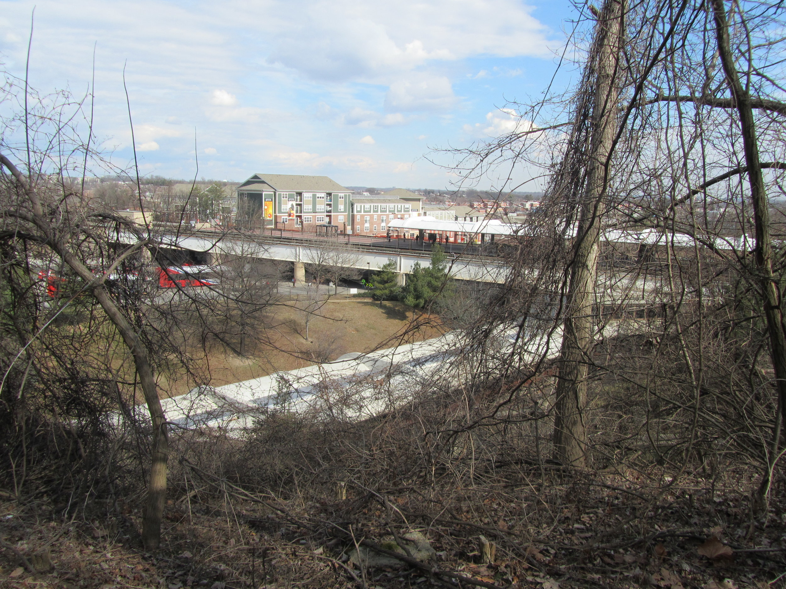 Image of the red line track at the Fort Totten Station, taken from the wooded area adjacent to the Fort Totten Metro Station