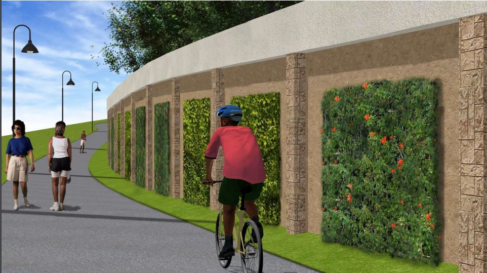 Image of an artist rending of MBT which shows 2 people walking and one person riding a bike on a paved path next to wall with green foliage embedded