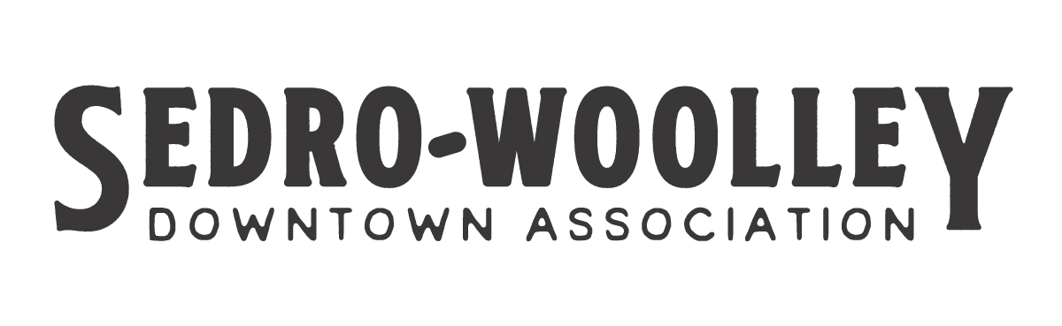 SedroWoolley-DowntownAssociation-Logo-Dark-Horizontal.png