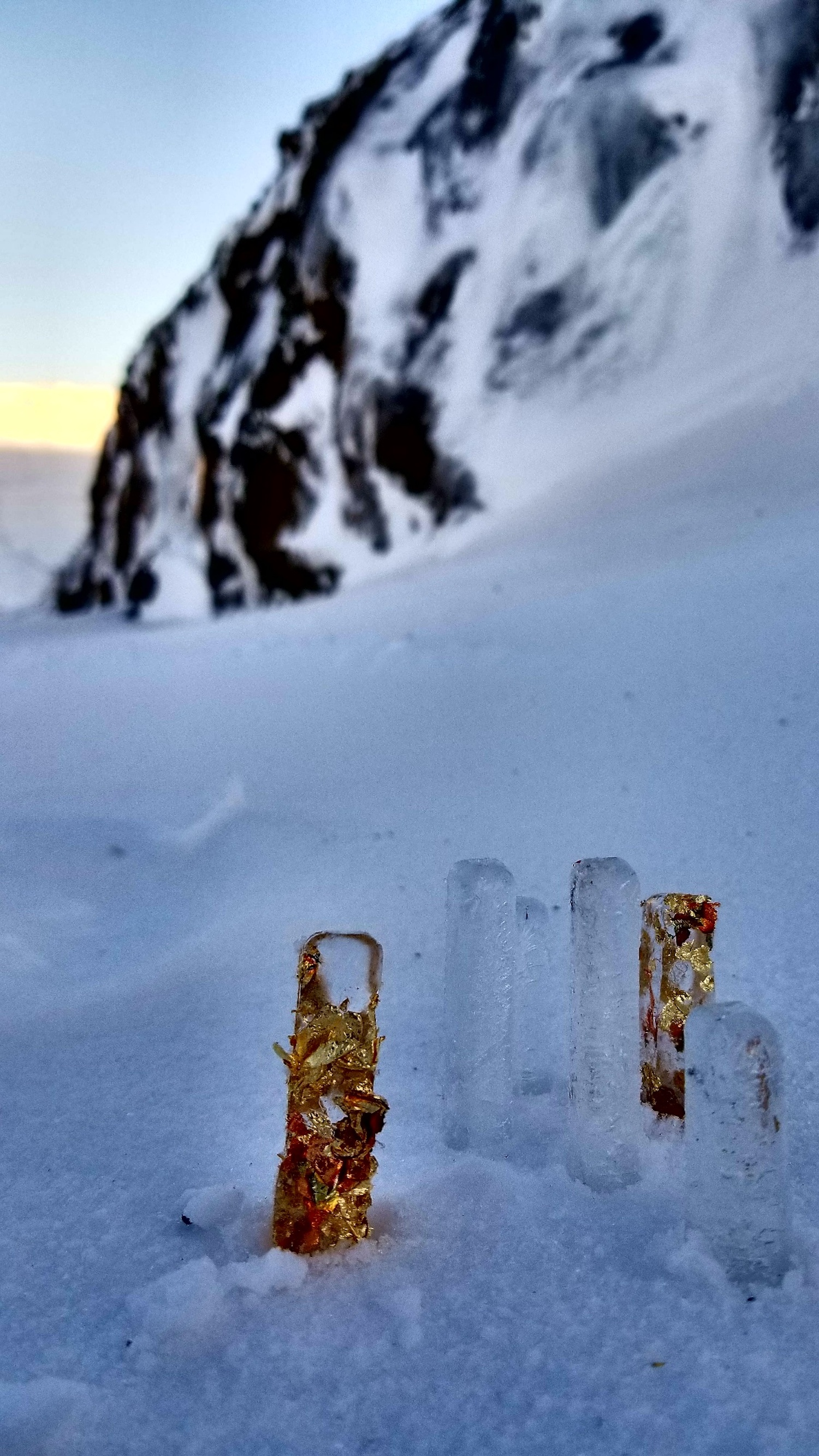 Gold leaf embedded in ice, installed in a snow drift in Suðureyri, Westfjords, Dec 2017
