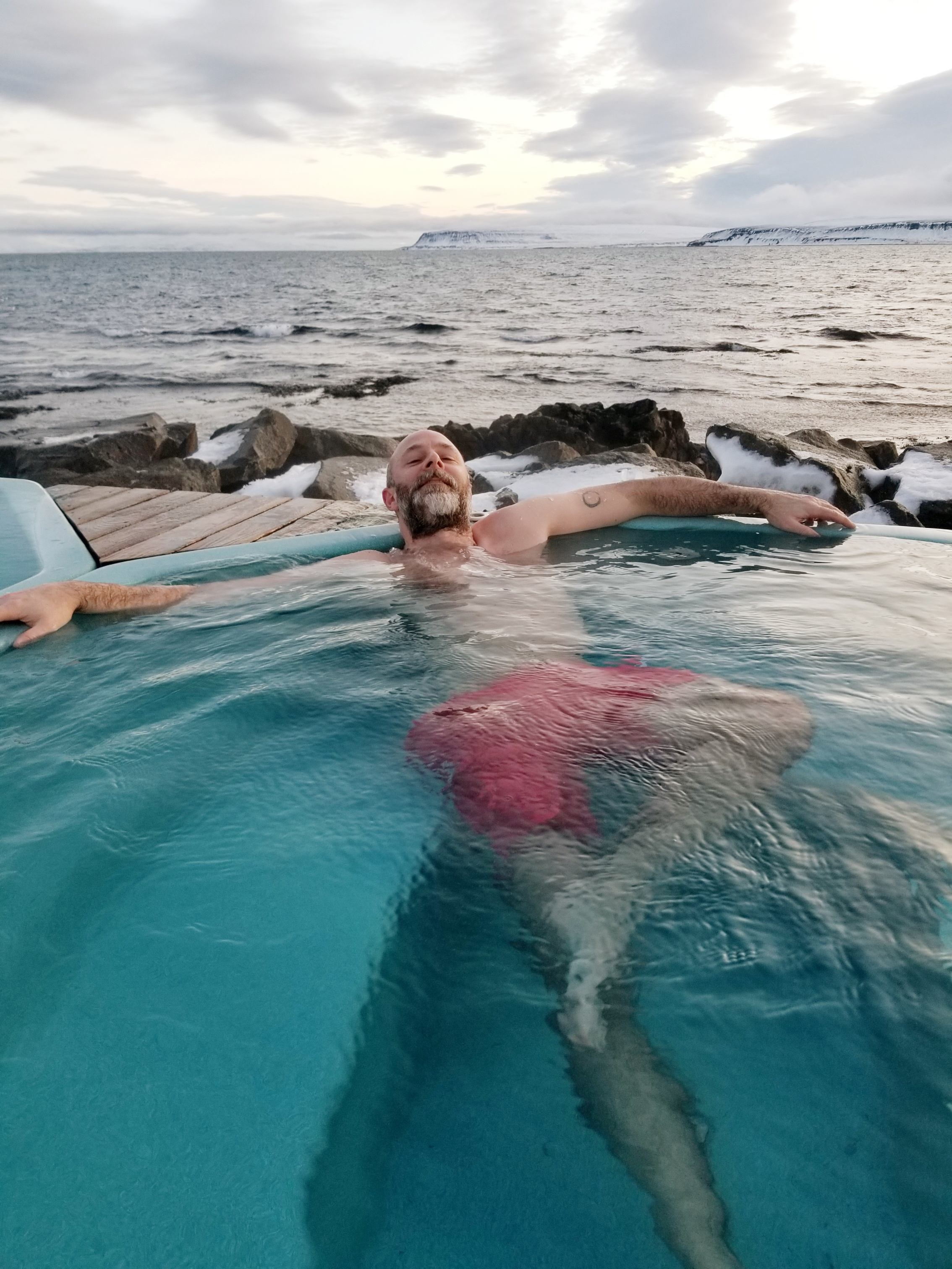 Chris, partner in crime, soaking seaside after a long day of ice installation in Drangsnes, Iceland.