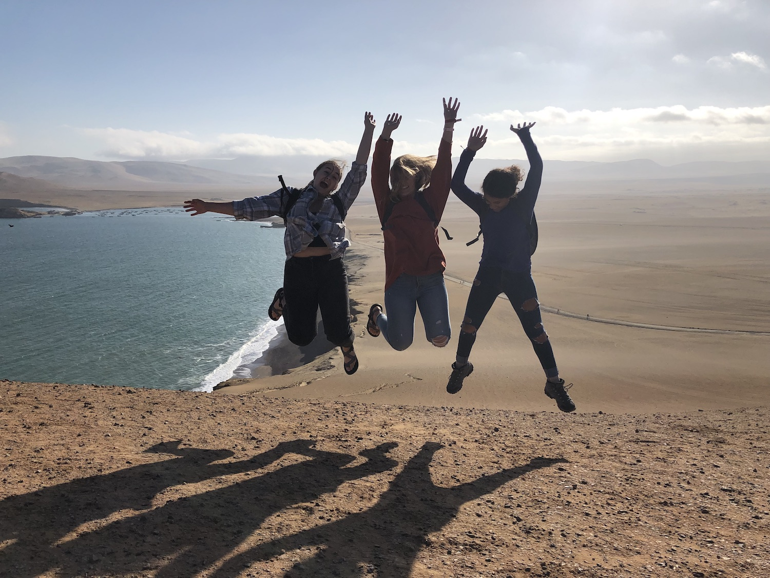 Zsofi, Devon and Brianna defying gravity above Playa Roja in Paracas, Peru, June 2019.