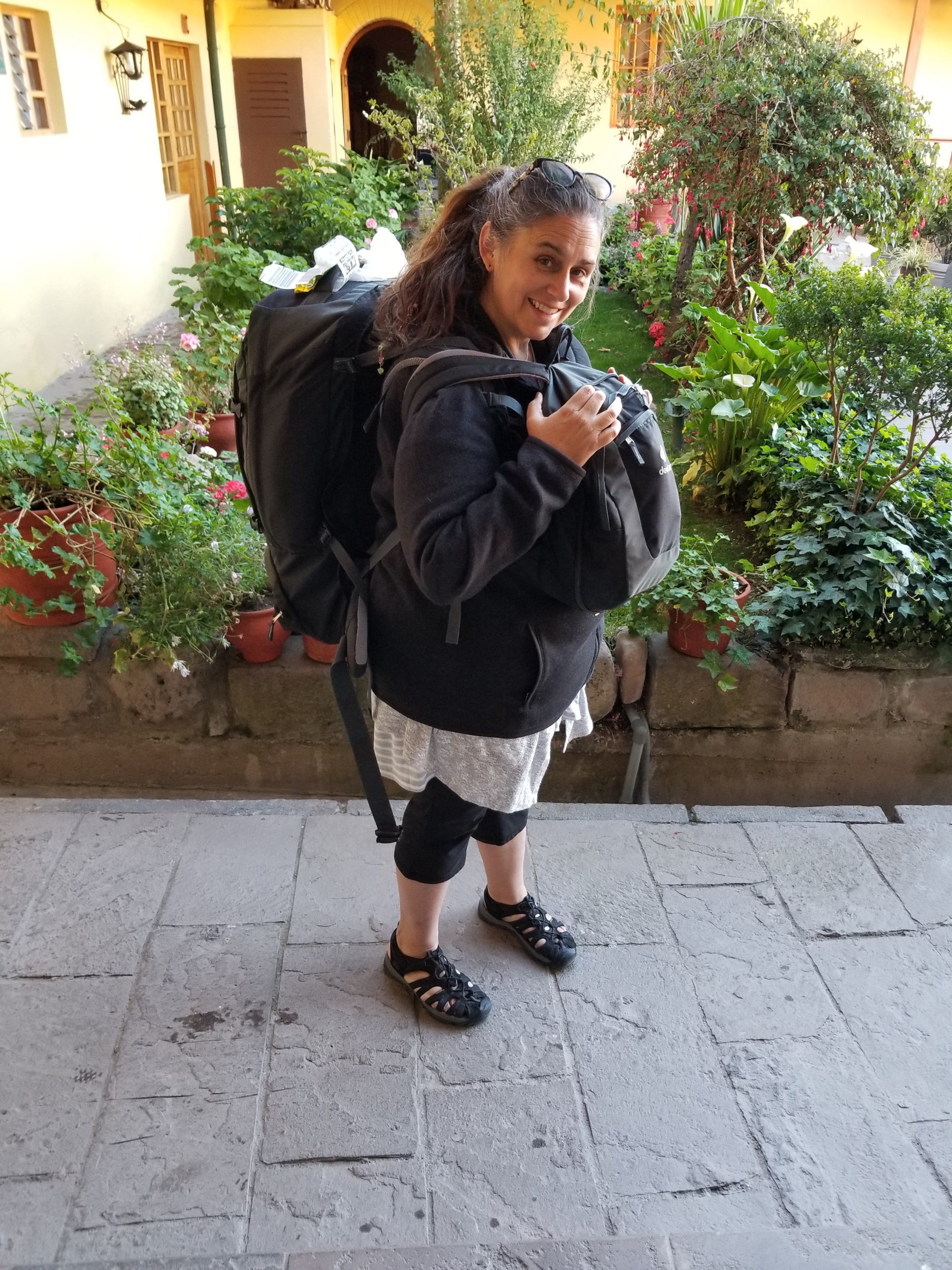 All loaded up in Cusco, Peru, with everything I could carry on my back (and front!), July 2019.
