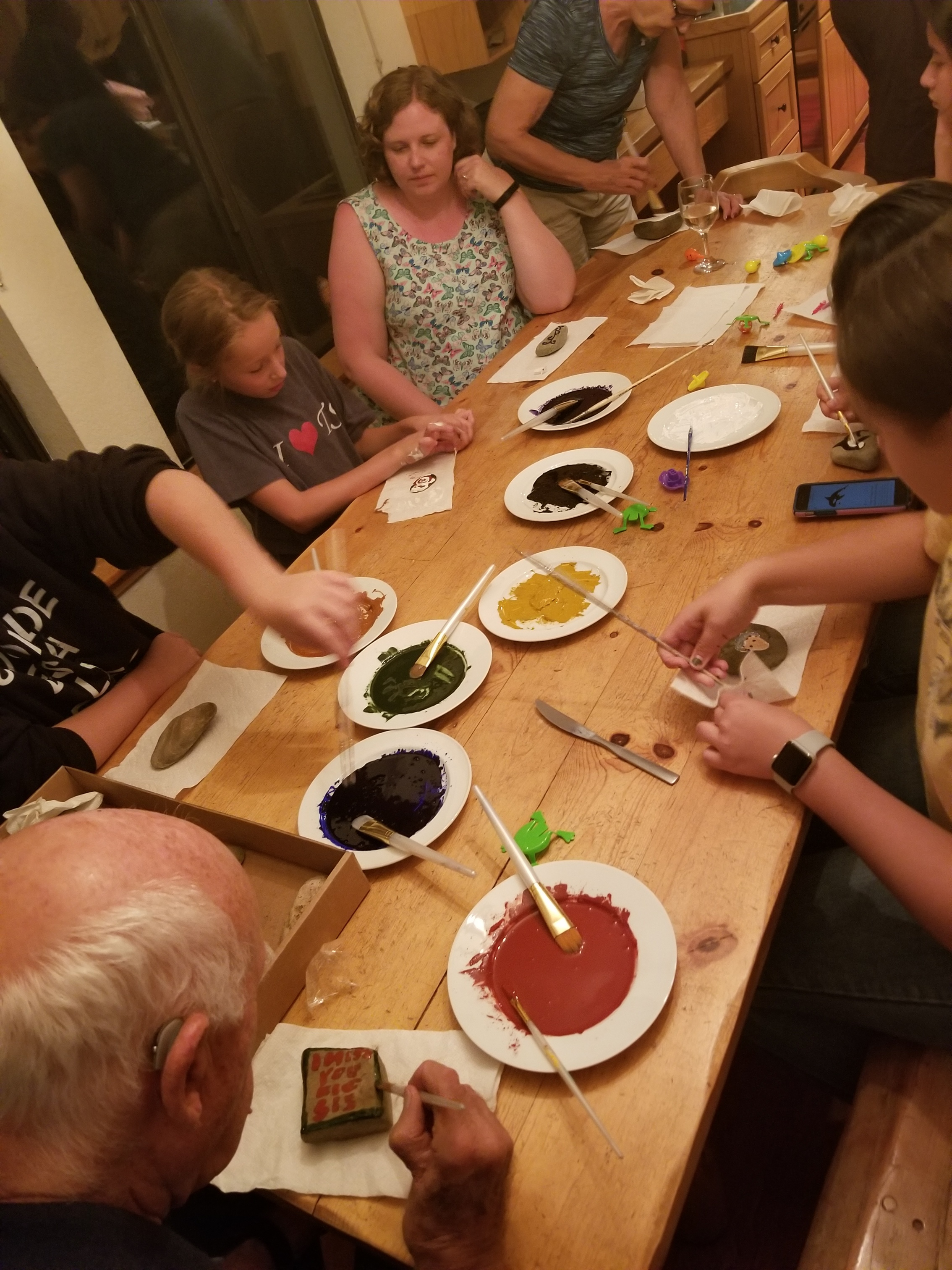 My family gathered for an evening of river stone painting with earth pigments and walnut oil, Ketchum, Idaho.