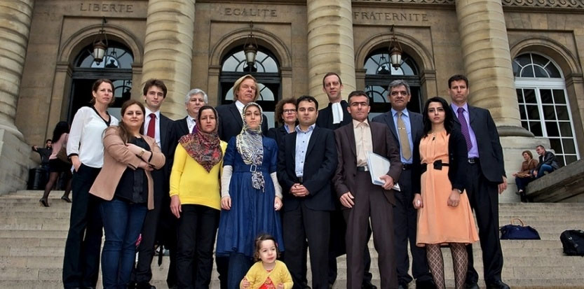 victims & attorneys on Paris courthouse steps.jpg
