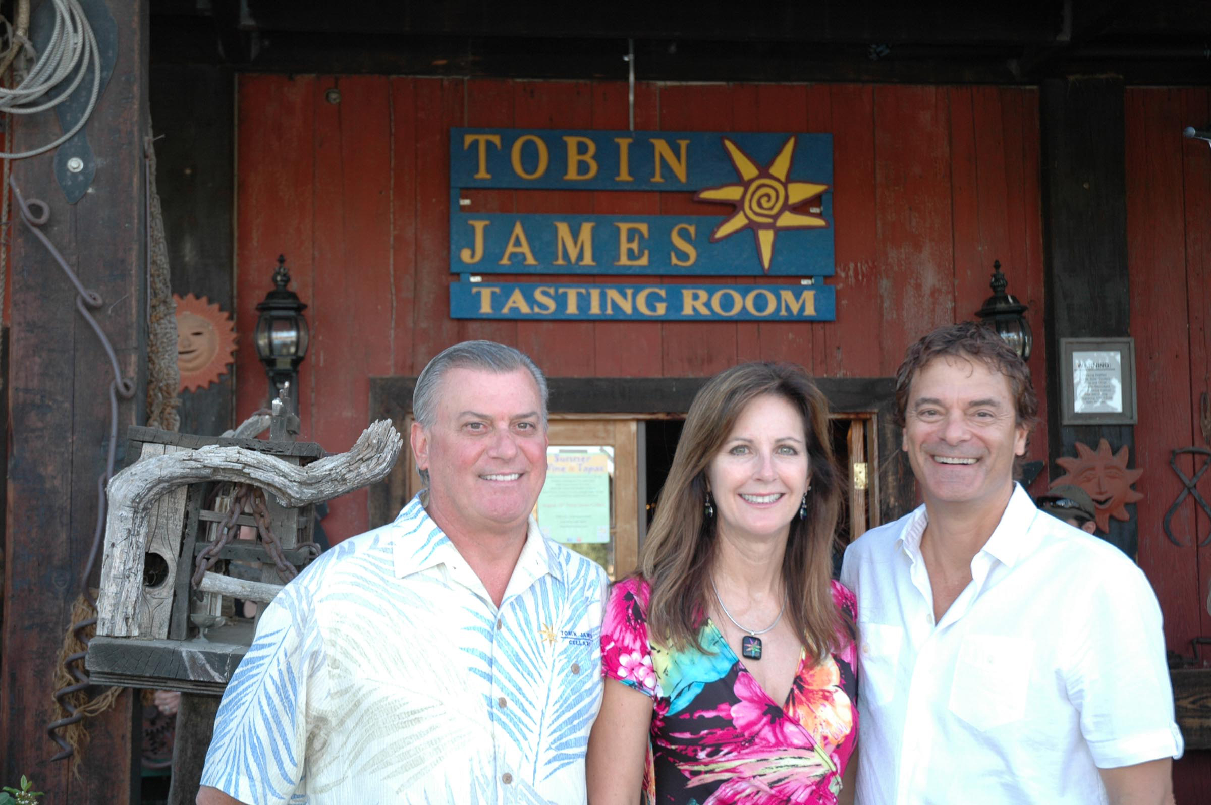 Photo of Toby, Claire and Lance in front of the Tasting Room