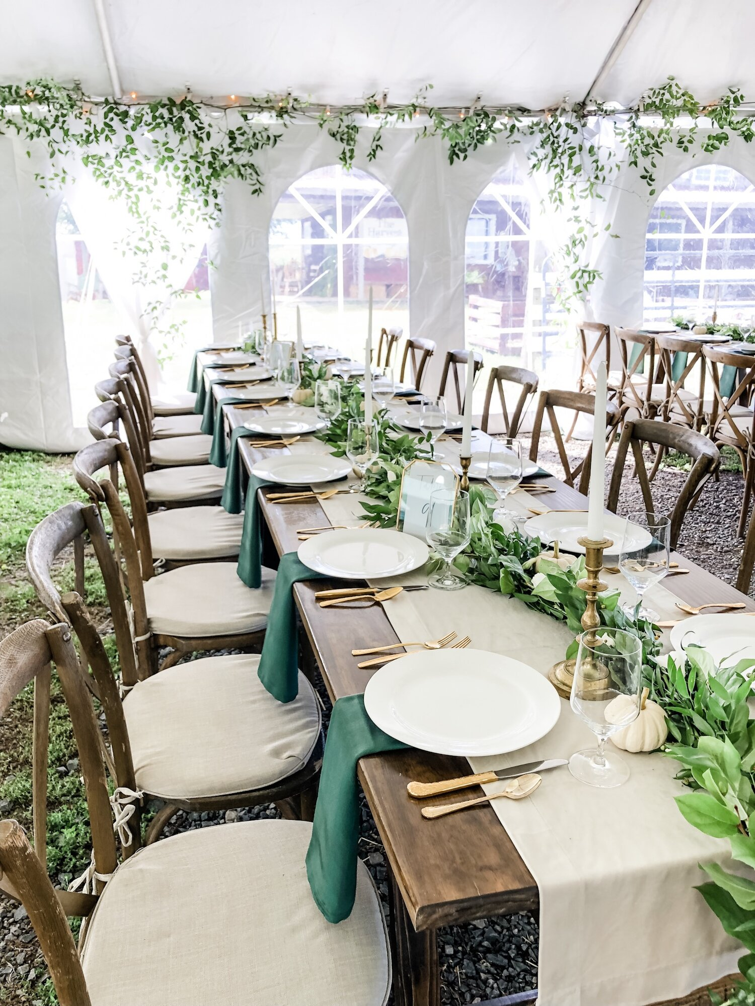 Planning design: Events by Carianne    Silverware: She Rents Vintage    Tent/Plates: Hank Parker    Garlands and Greenery: MoonRise Floral