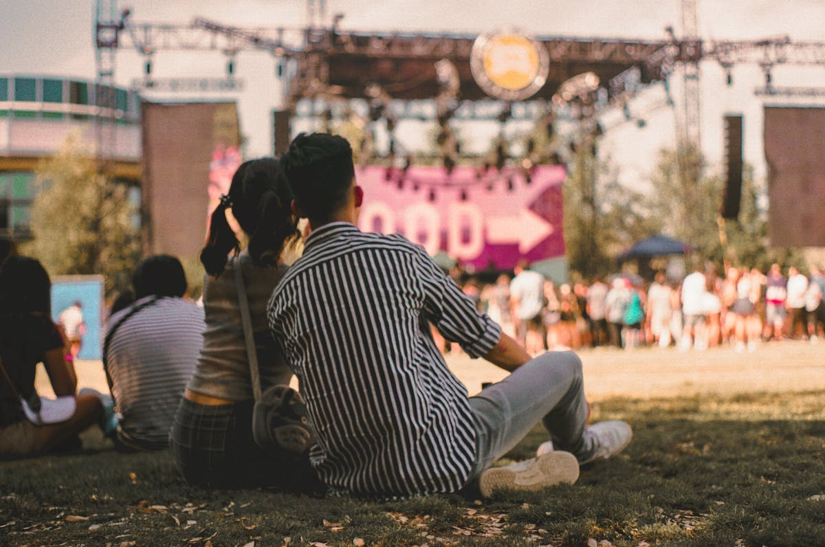An outdoor concert is a great opportunity to leave your stresses behind and enjoy time with your significant other.