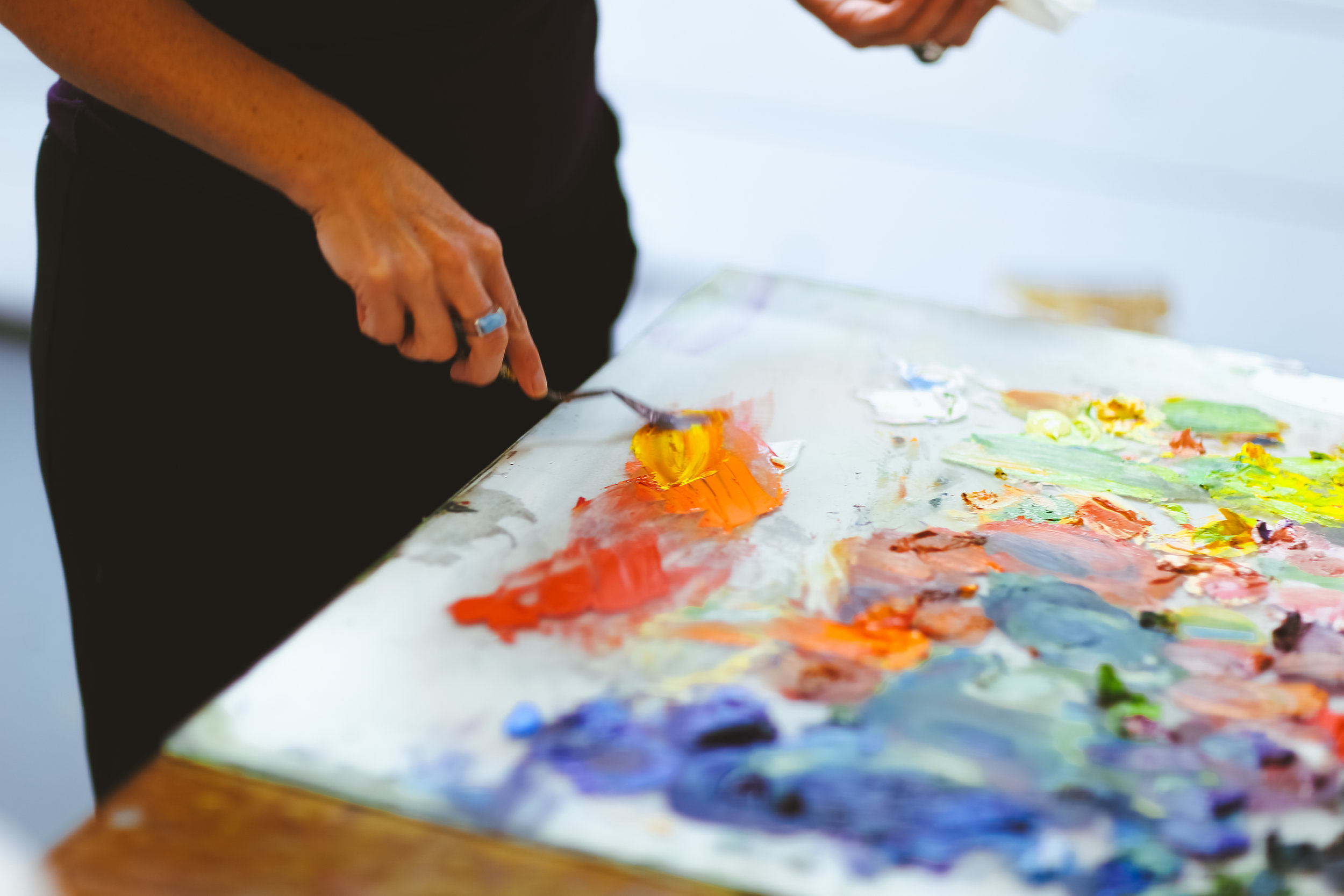 Mixing paint on my palette - I use a large piece of glass on a table, backed with white or grey paper.