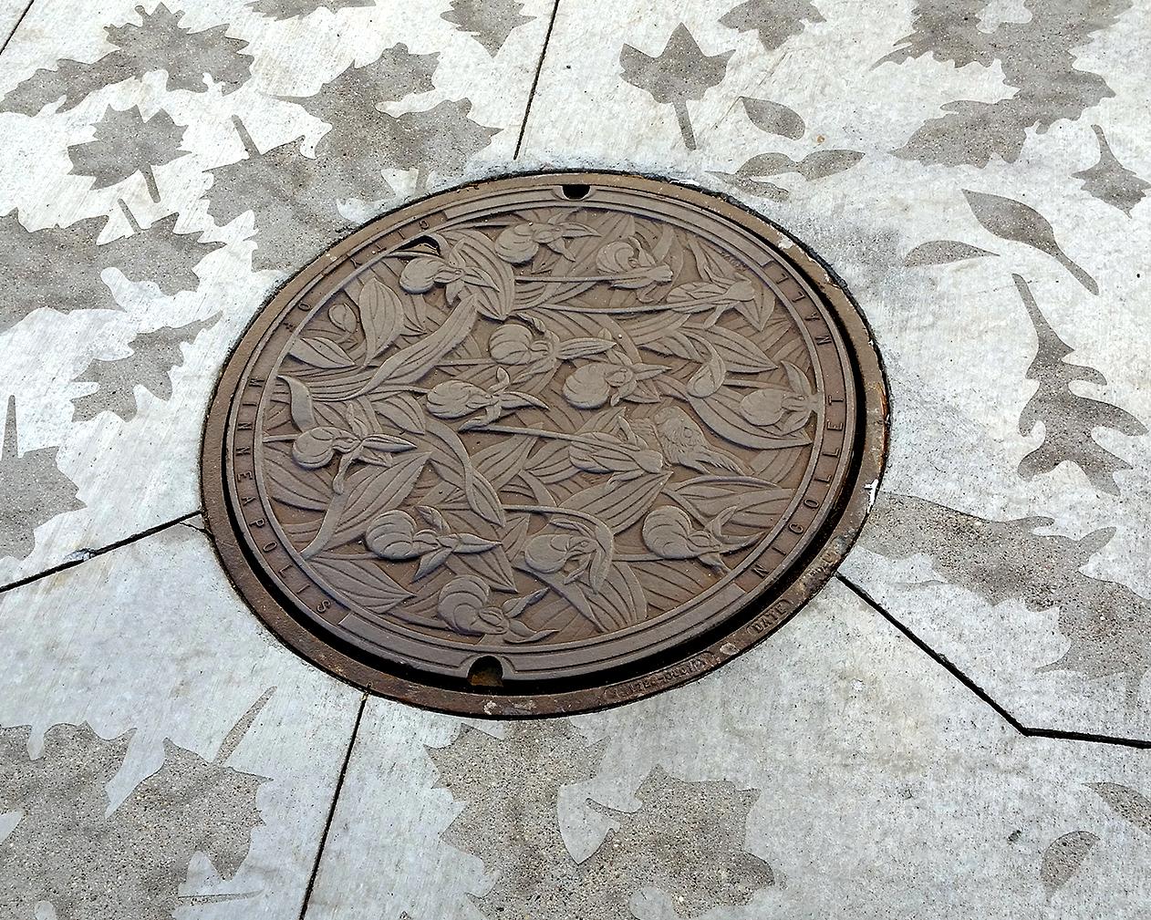 Hail Minnesota manhole covers by Kate Burke
