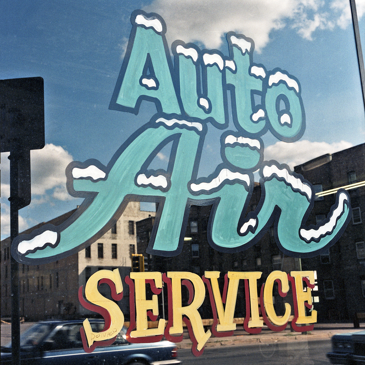Automotive Repair Service, Downtown Minneapolis, Minnesota. July 1988. Hand-lettered signage on one-block-square garage that was torn down and replaced by the Saint Thomas University campus.