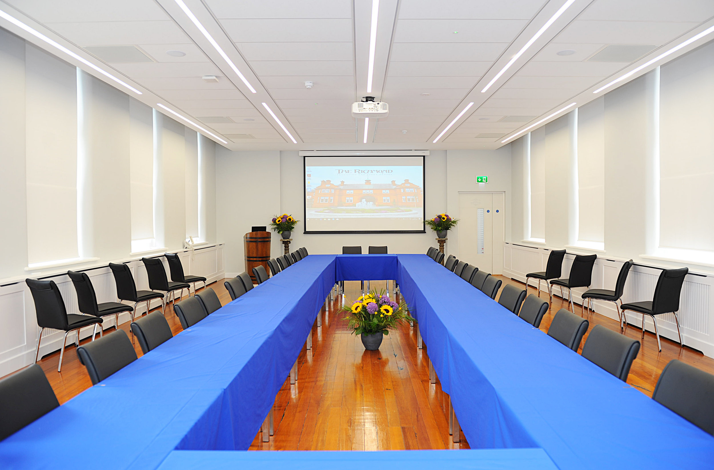 Lecture Room - The Lecture room is a large and elegant space filled with natural light. It has the space and flexibility to be adapted to many layouts. It includes a HD projector and screen and dimmable lighting. A popular choice for boardroom style meetings and for education sessions and seminars.
