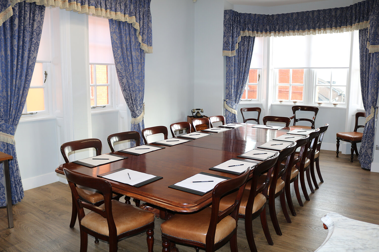 Dining Room - The first floor fine dining room is a private, elegant space, occupying a high-ceilinged room with a view of our courtyard from the bay window. This space can seat up to 12 people. It is a popular choice for boardroom style meetings and for dining.