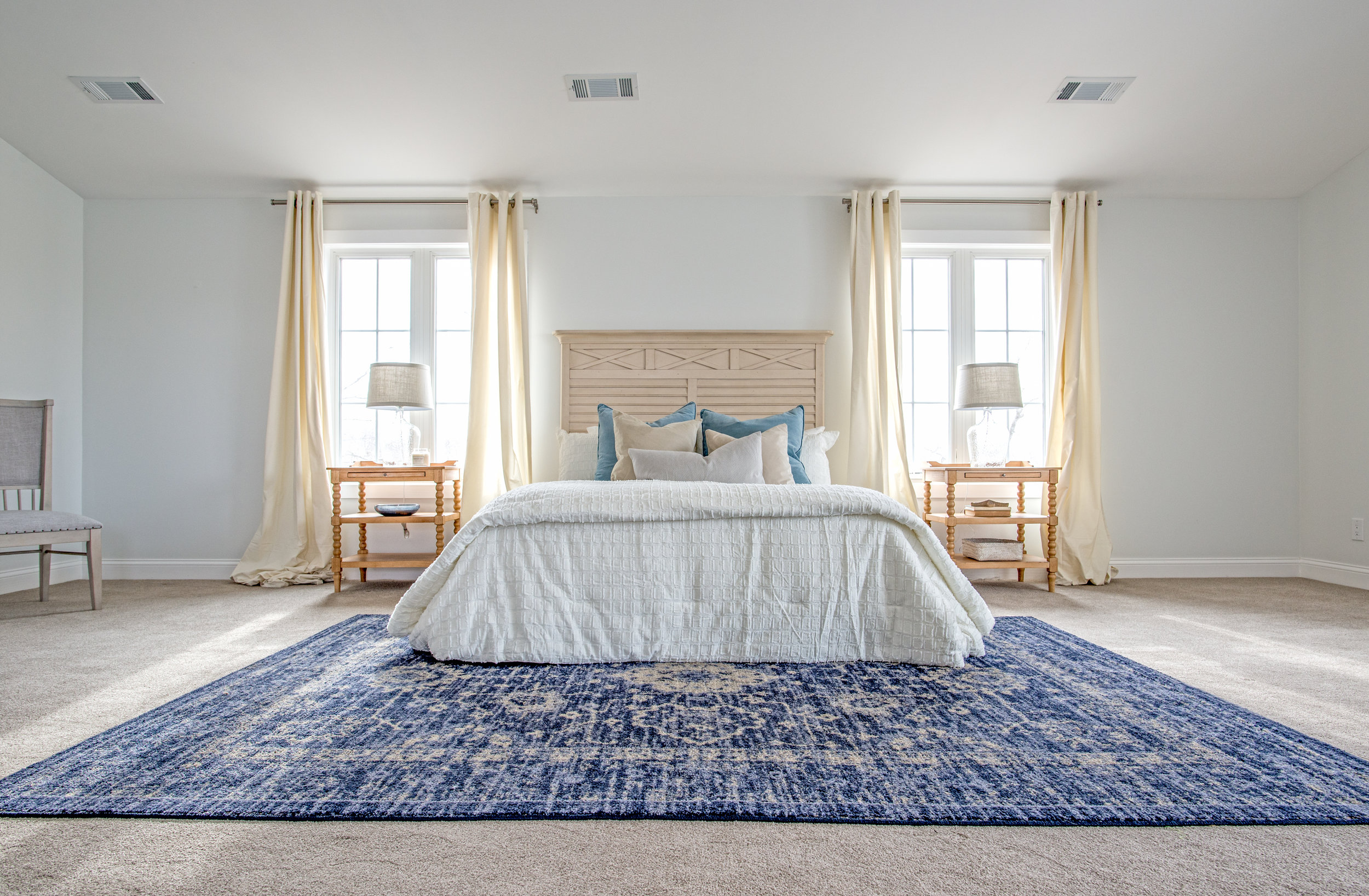 A simple staged bedroom at a recent shoot in Lake Lotawana for RootedKC Design & Realty.