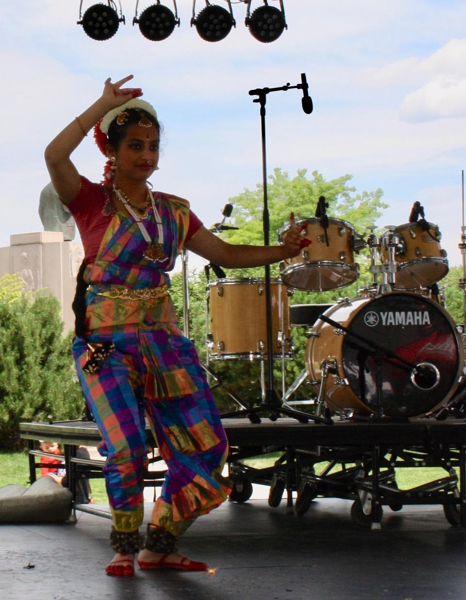 "Alekya performs "" Pushpanjali""  on stage at the World Village Fest."