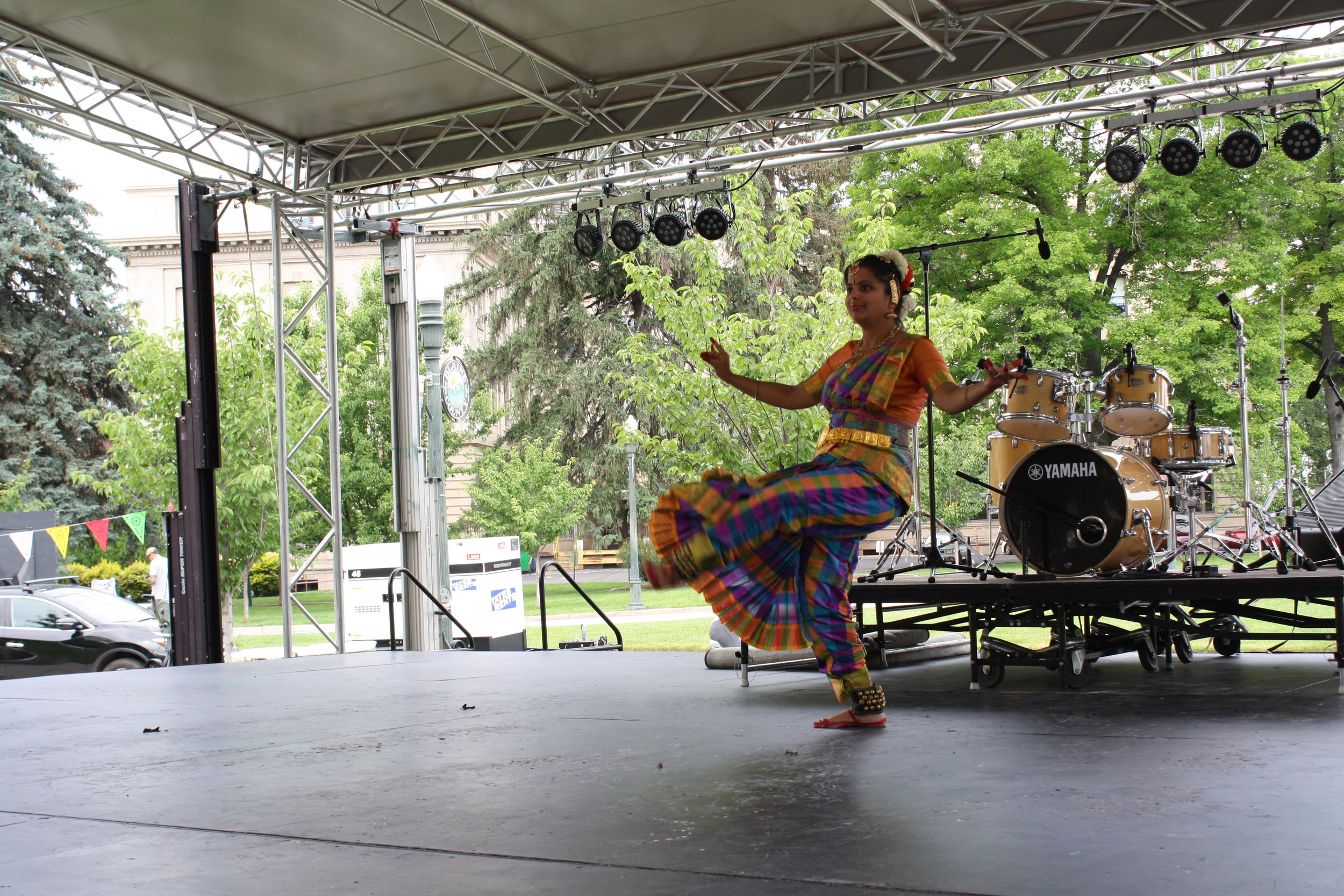 """""""This dance form symbolizes a perfect culmination of body, mind and soul. We show it through movement of eyes, neck, face, arms and your legs along with your posture."""" –Padma Gadepally on the World Village Fest Stage."""