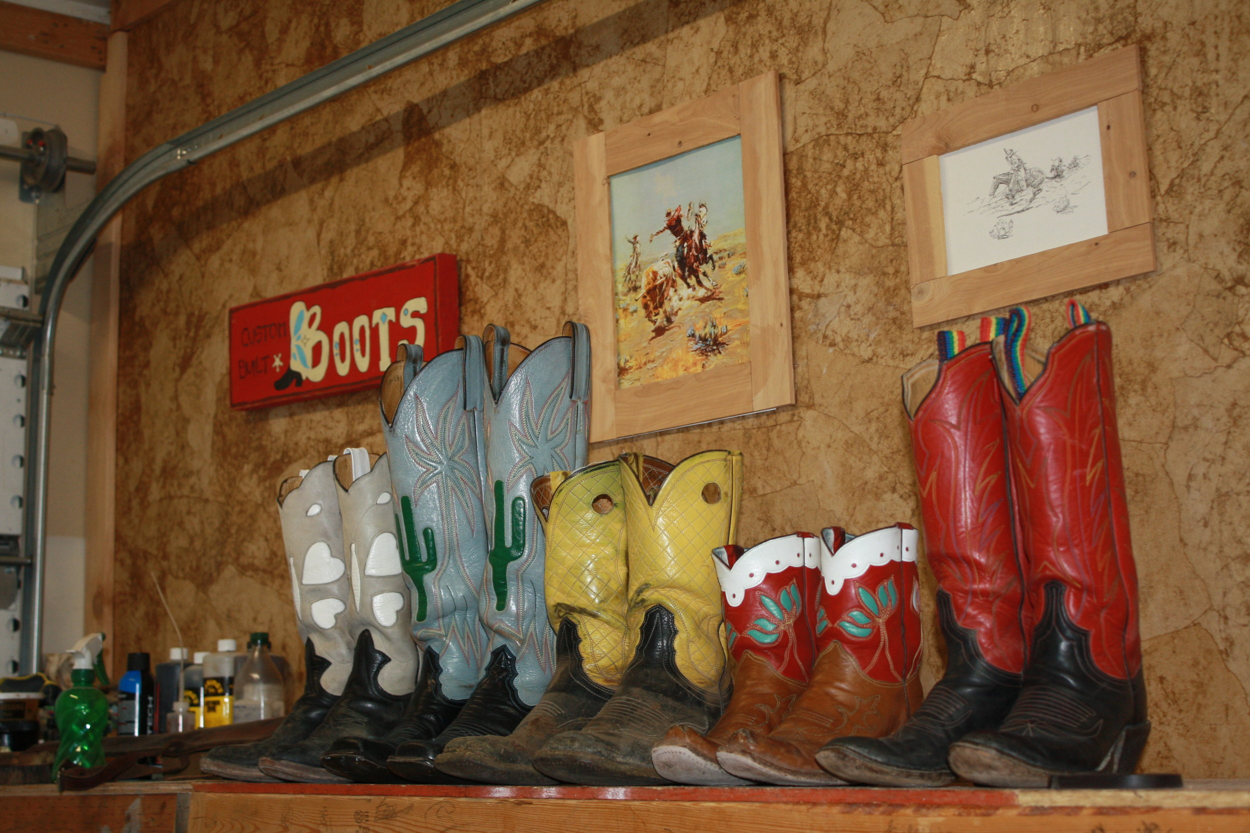 This is a selection of boots by Seth Teichert. He is known for building pull-on cowboy boots with tall tops and a slung-back heel.