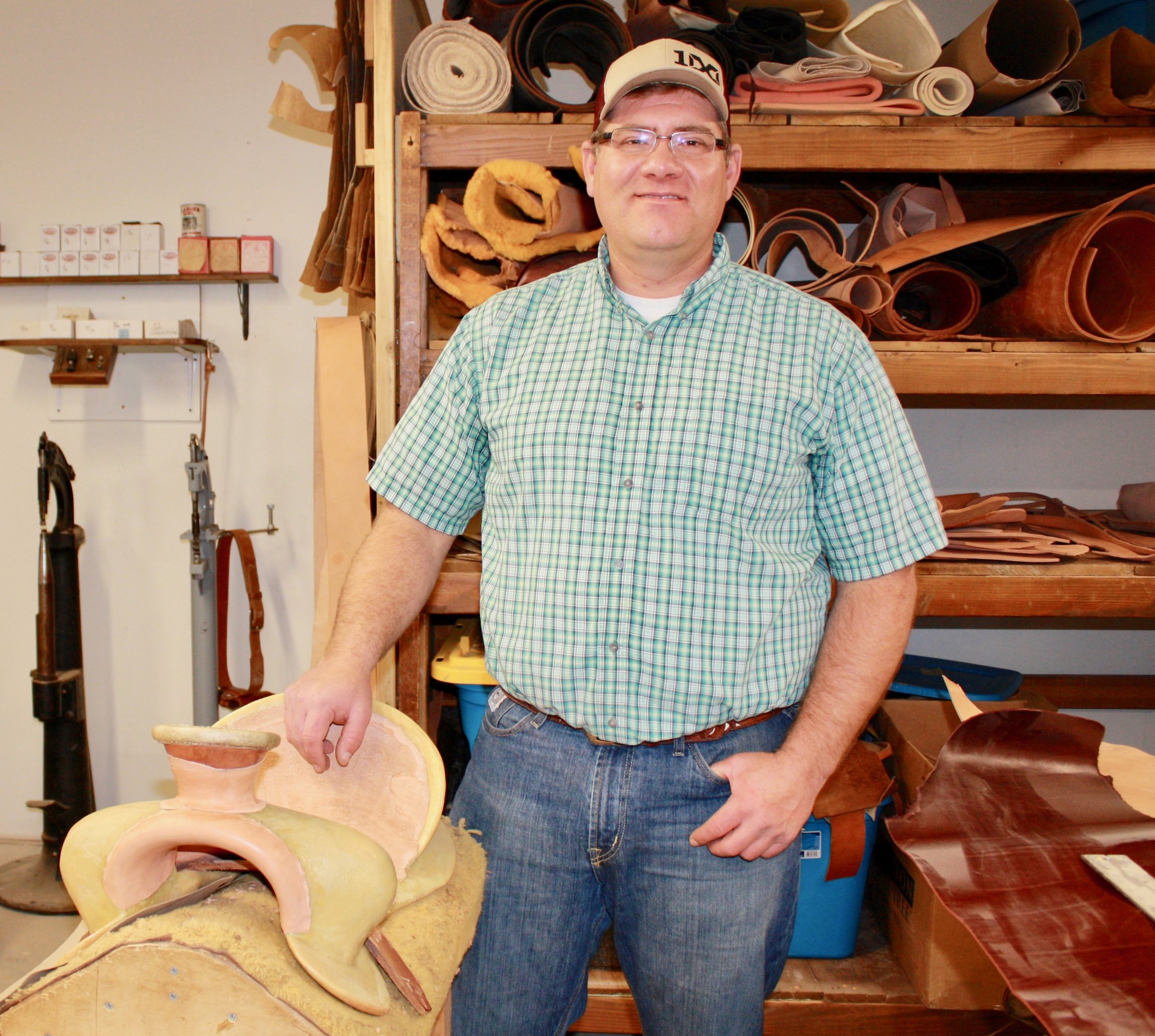 Saddle making apprentice Hans Hansen of Melba plans to use this saddle for team roping and ranch work in Owhyee County.