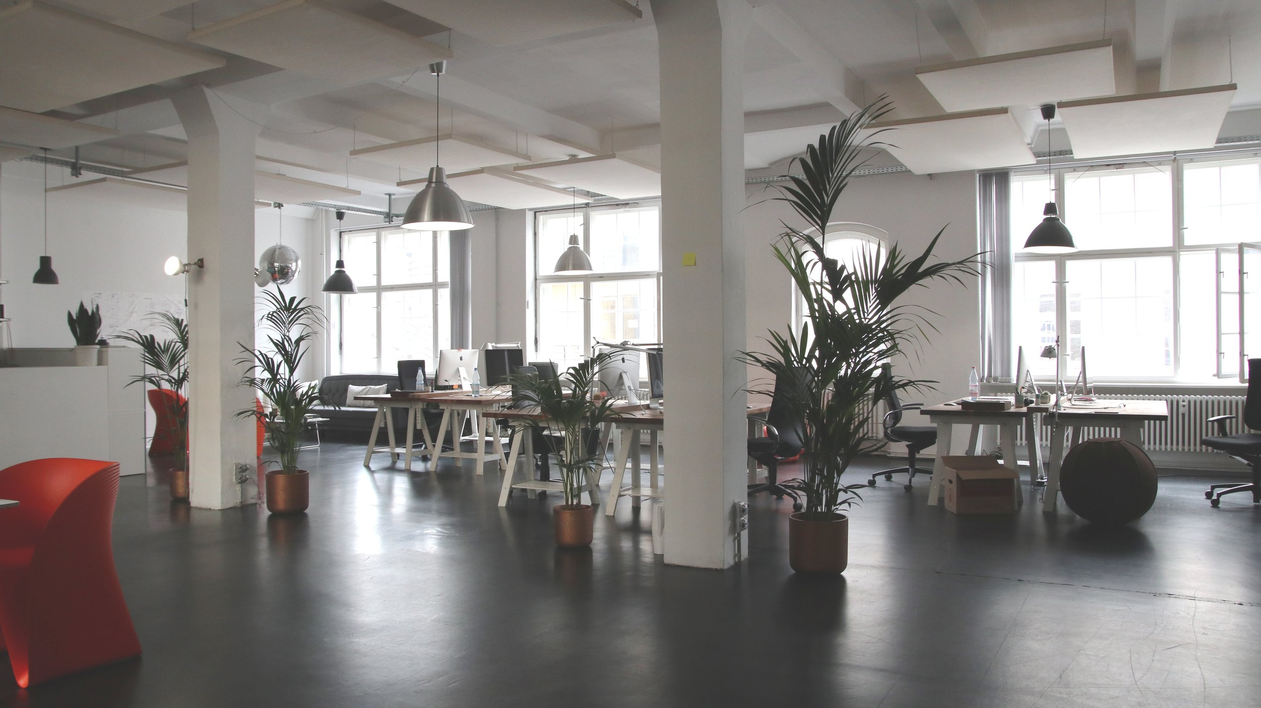 Harvesting daylight by placing open workstations near windows allows all users to enjoy the benefit of natural light while allowing light to fully penetrate the interior of a space.