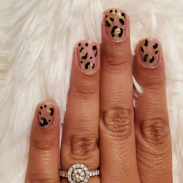 Gorgeous negative-space mani by @beneaththepolish featuring BACK IN BLACK MATTE and GET FAMOUS.  Thank you for sharing! ・・・ •Negative Space Leopard Mani • . . If you've been following me for awhile, you know how much I've been struggling to keep polish on my nails! I decided to try a negative space mani. Let's see how this holds up. I haven't done nail art in a while and I still got it! If you're looking for a good tutorial on Leopard print nail art, check out @chalkboardnails. . 💅 @ladyvlacquer in Get Famous and Back in Black . . . #ladyvlacquer #negativespacenails #leopardnails #nailart #shortnails