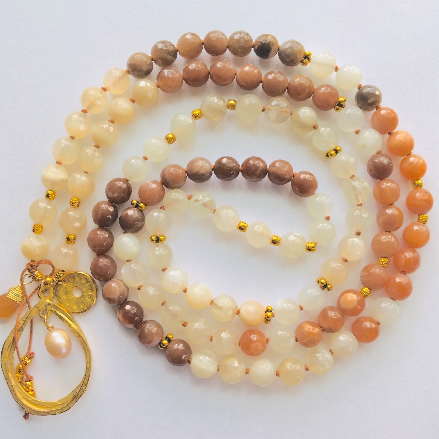 Sweetness of Life Mala   Shades of Moonstone. Moonstone assists the hearts as it stimulates the mind, soothing anxiety. The energy of Moonstone is an emotional support for sensitive people and is thought to help enhance one's emotional vision bringing greater creative abilities and freedom of expression. It's also known to help with absorption of essential vitamins and minerals.