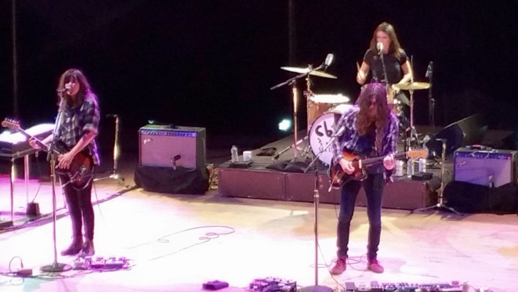 My photo of Courtney performing with Kurt Vile at Massey Hall. The drummer in the background is Stella Mozgawa from the band, Warpaint.