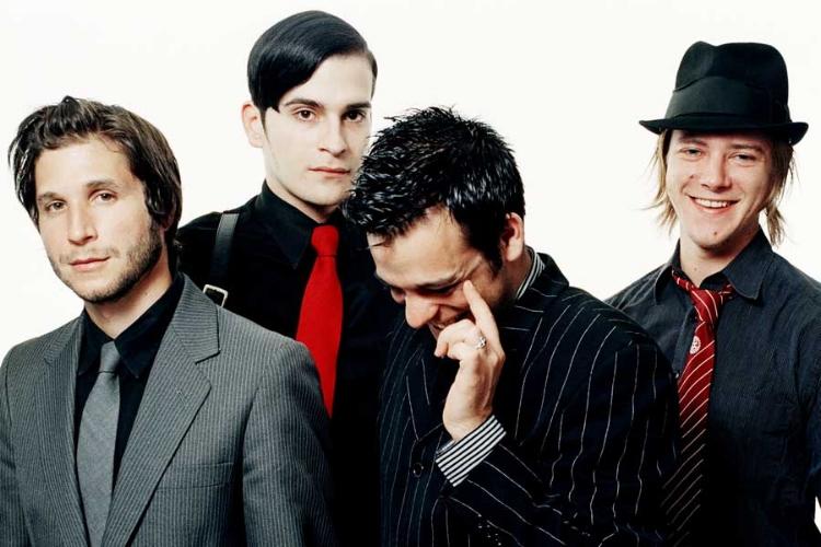 Interpol then: Daniel Kessler (guitar); Carlos Dengler (bass); Sam Fogarino (drums); Paul Banks (vocals, guitar)
