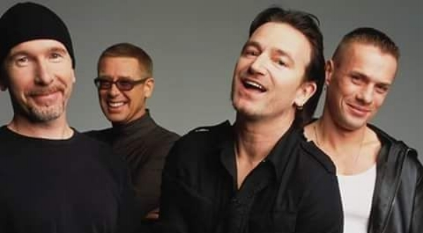 U2's earnestness has been a source of respect and derision, so a picture of them looking less serious was a nice change (circa 2000).
