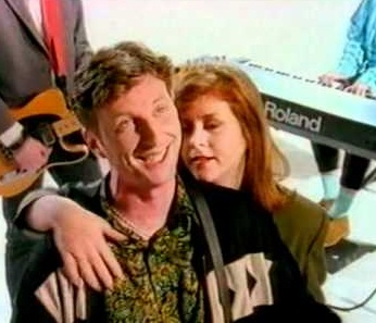 "Bragg and MacColl in Billy's video for 1991's ""Sexuality,"" in which Kirsty provided backing vocals"