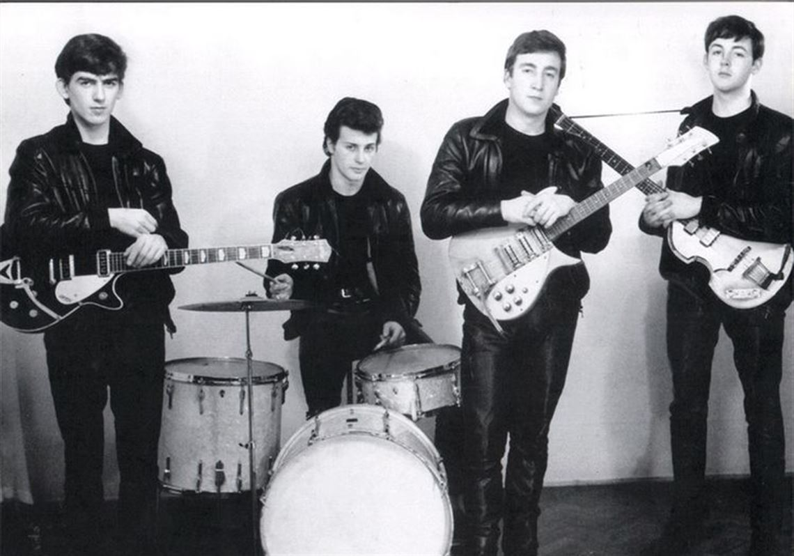 Before breaking it big, The Beatles went through a leather-clad, garage rock styled phase while playing in Hamburg. This picture includes Pete Best on drums, before Ringo Starr replaced him.